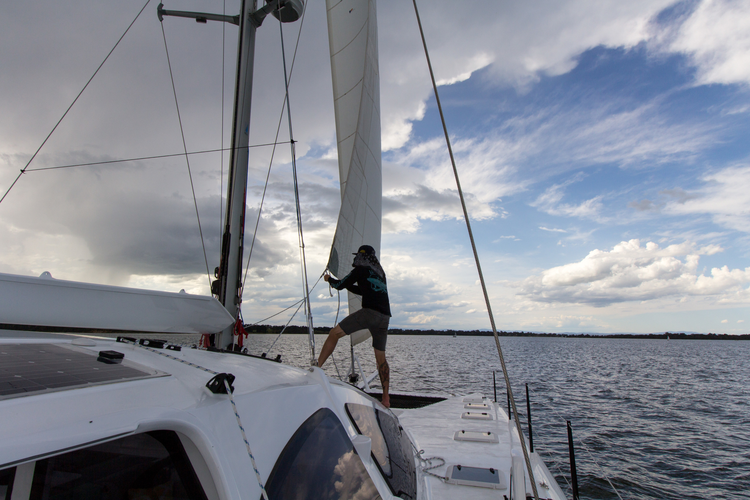 Barber hauling our borrowed headsail to get the maximum speed out of the slight breeze we had. Made 6.3 knots in 12.8 knots of breeze.