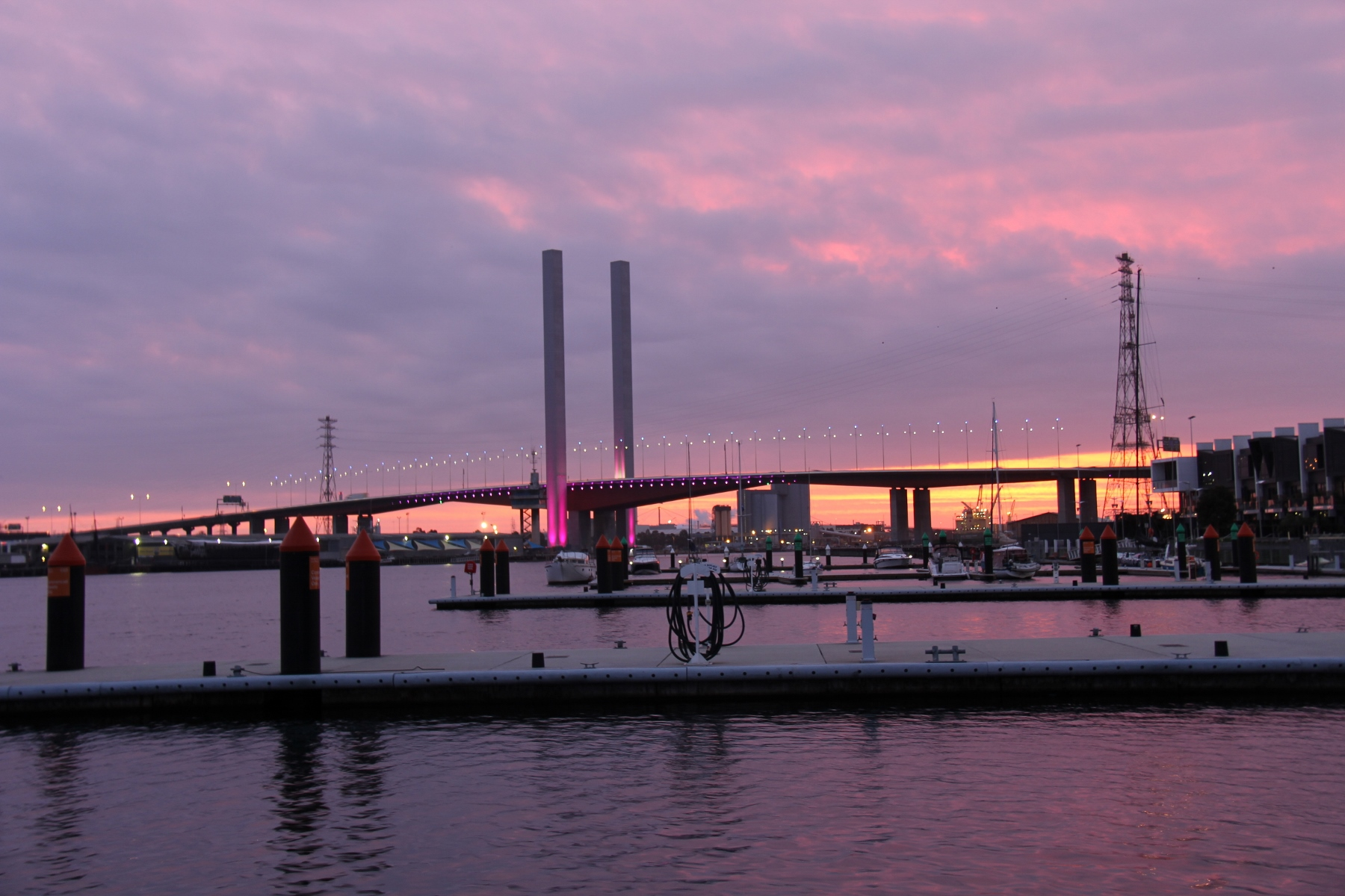 The pretty night time views from Roam at Docklands Melbourne city Marina .