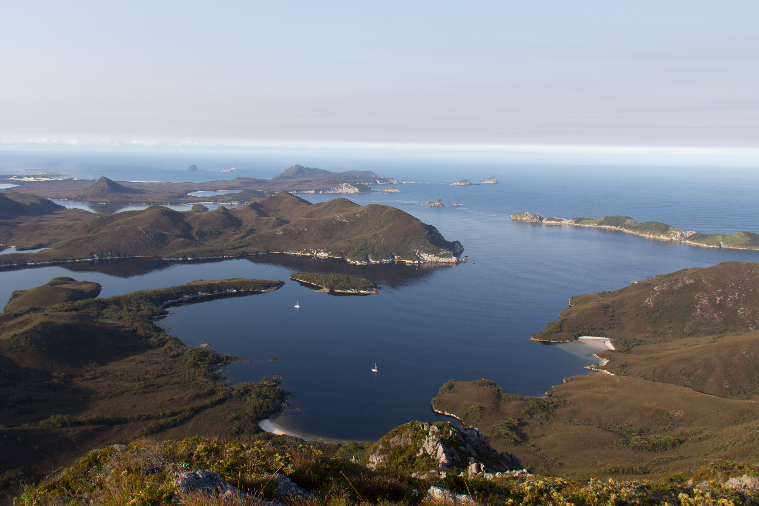 Mount Misery summit looking South West with ROAM anchored just inside Sarah Island.
