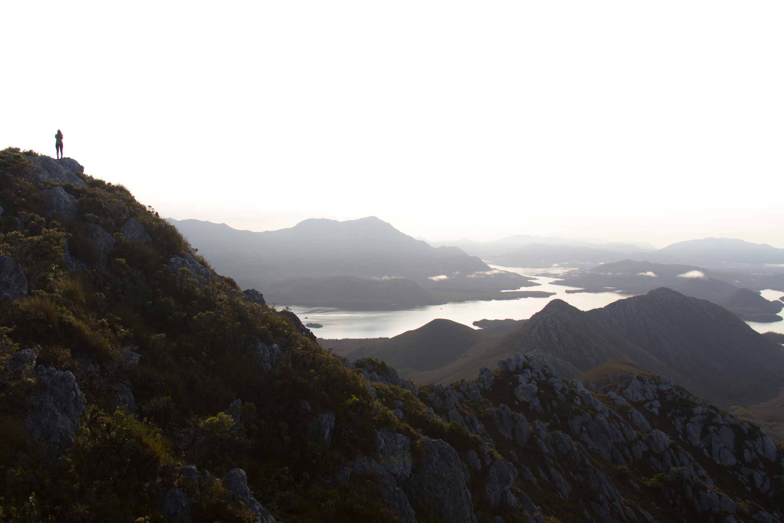 The view towards Bathurst Harbour and Mount Rugby with Liss on the Summit of Mount Misery.