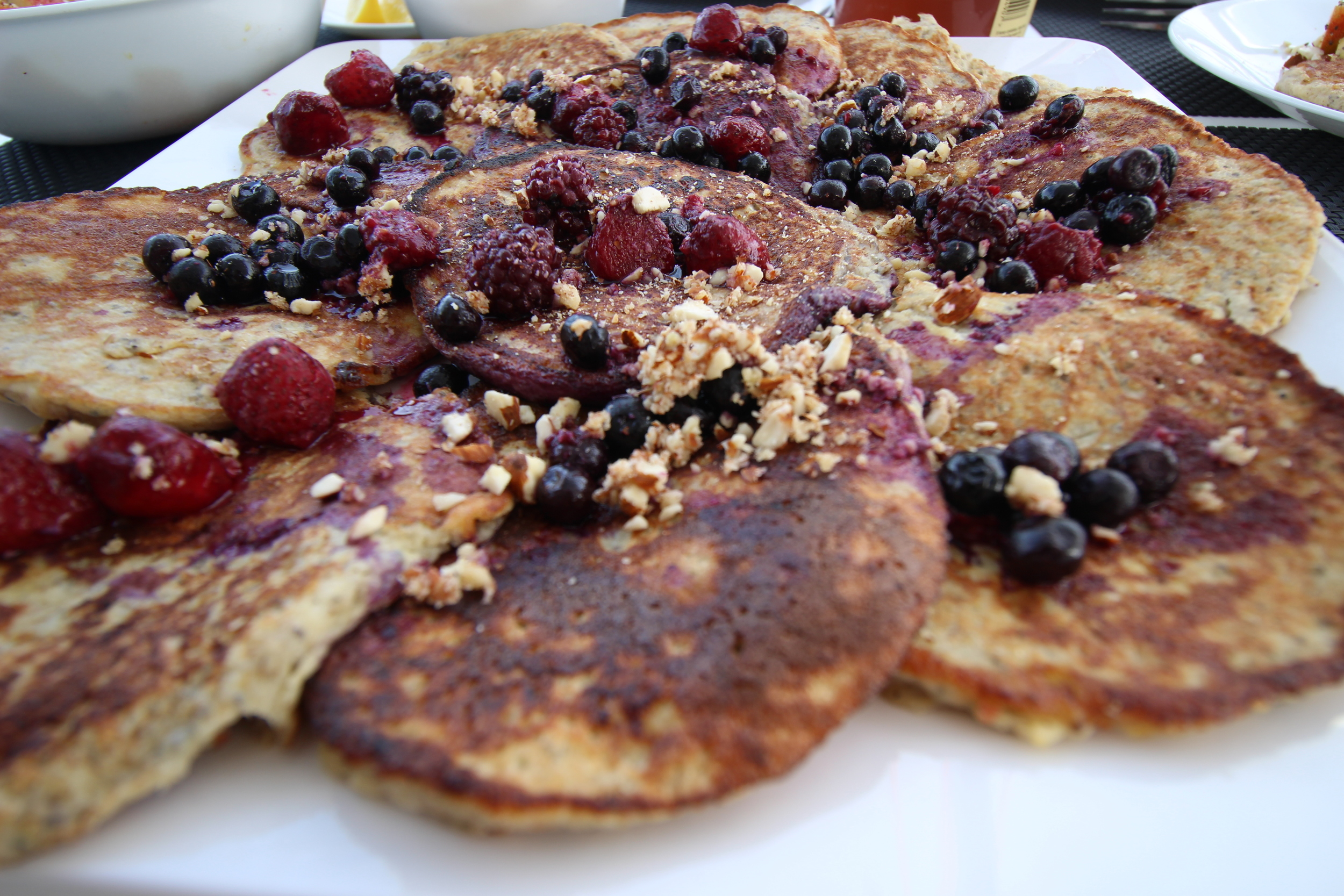 Banana and coconut pancakes we enjoyed with banana ice cream berries, fresh orange juice and fruit salad in an attempt to eat as much of our left over fruit as we could so it didn't go to waste.