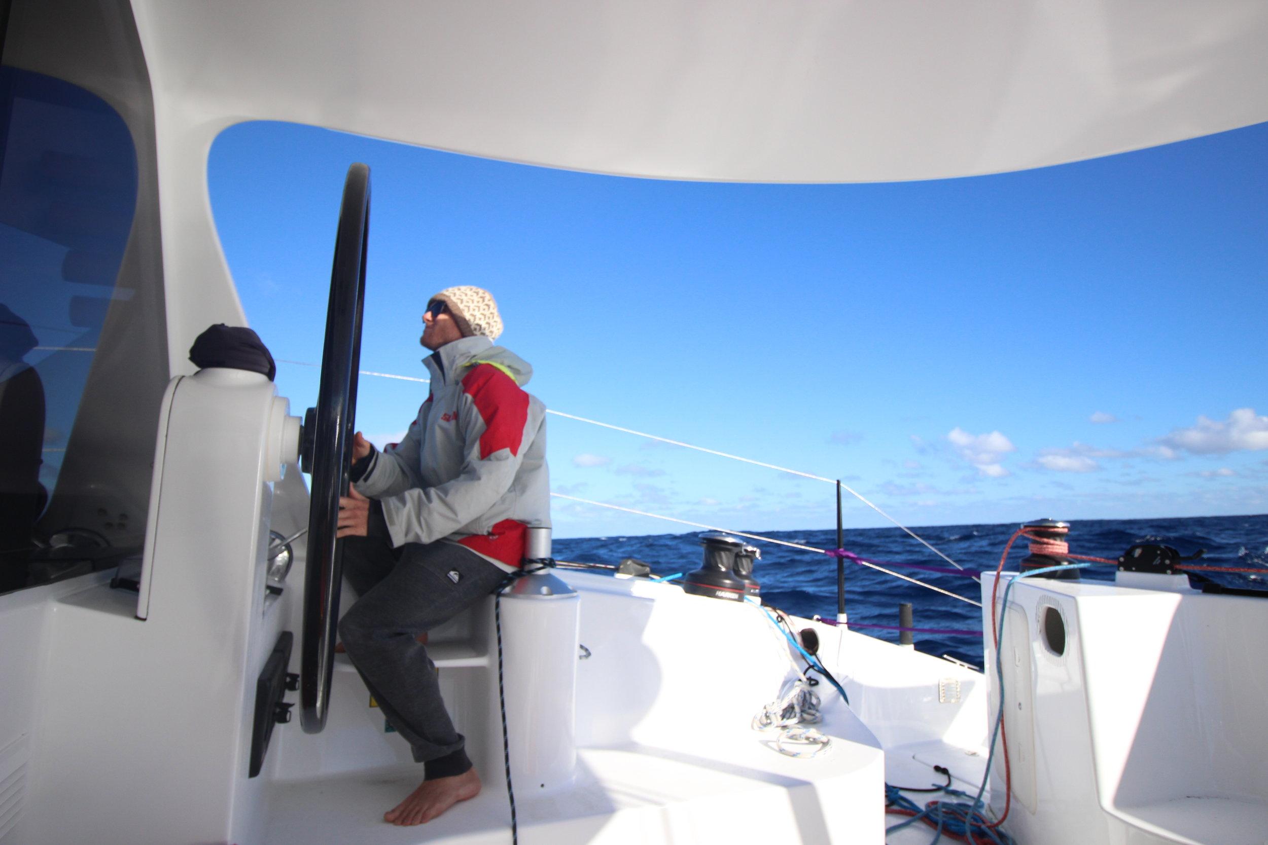 mick at the helm enjoying hand steering