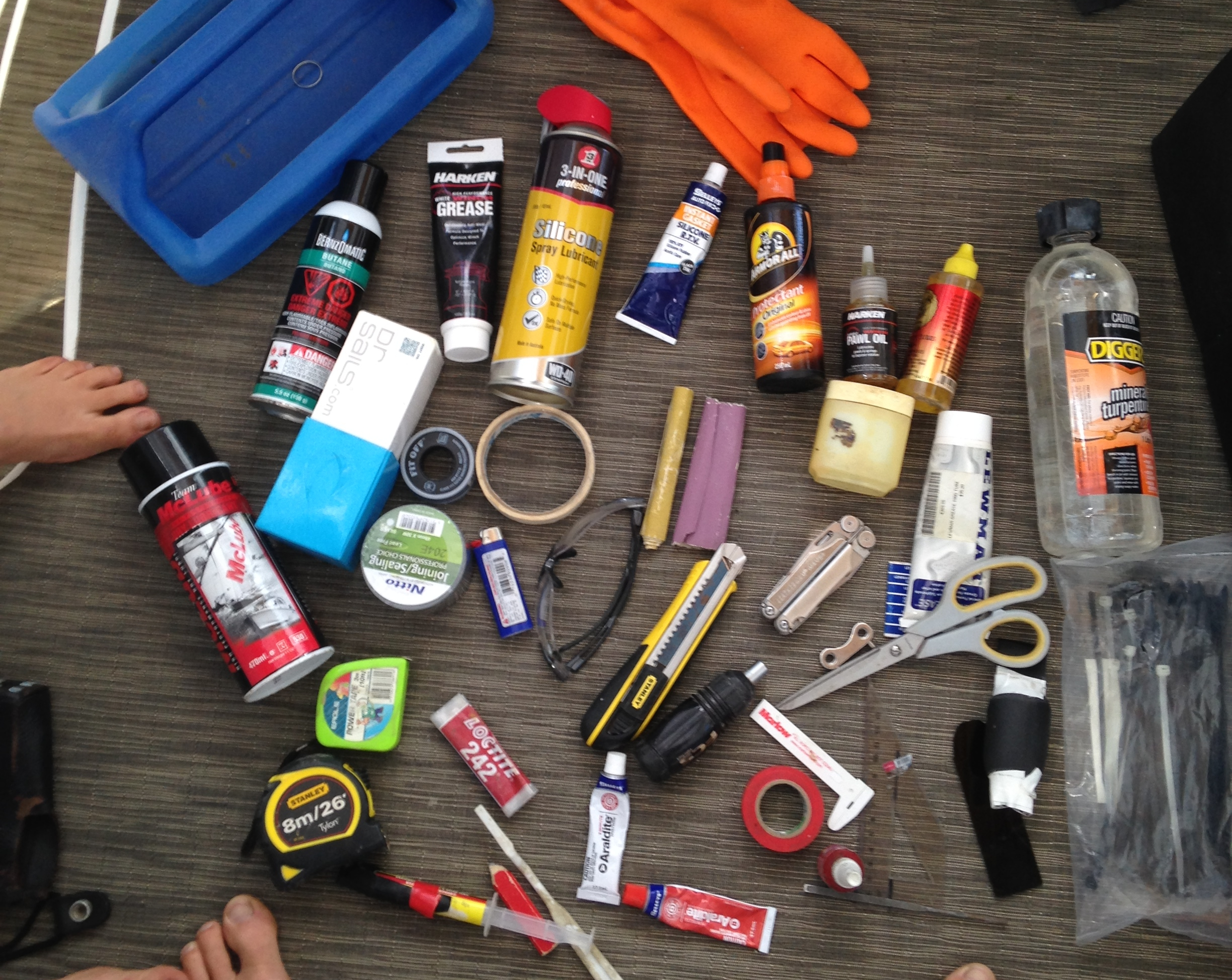 """This is the contents of our """"tool tidy stool"""" Its the kit need within arms length every day. I'm not sure why I have two tape measures. That is a potential weight saving if ever there was one."""