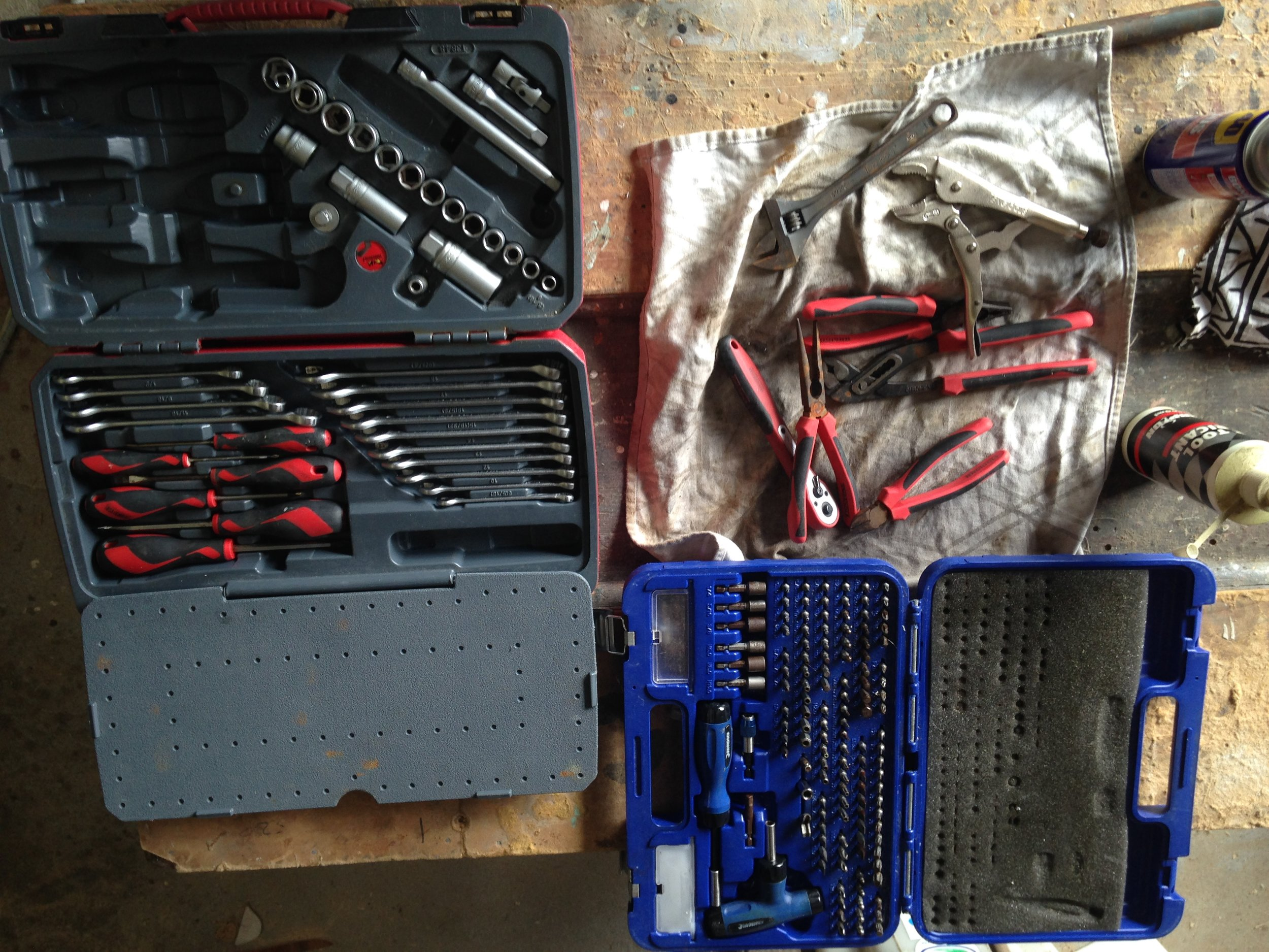 """I think I kept my eye out for the right tool kits for about 4 years before deciding on these ones. The one on the left is a 1/2"""" drive Metric and Imperial kit from Teng Tools (8mm - 19mm). It covers 95% of all the fasteners onboard. There are a couple of smaller sockets and one bigger one that I have loose in there for a couple specialty jobs. 7mm Hex Machine screws on the engine water pumps and a large 22mm socket holding the props on etc.  On the Right is what I call the """"everything everything"""" driver set. Its got you covered for the unexpected non standard fastener as well as full size ranges of all the standard stuff. Its from Kincrome.  Both of the kits have hit the mark for being decent quality without being crazy expensive and with semi regualr bath of WD40/Lanox/air tool oil they are holding up in the marine environment OK. They are getting a spring clean when this photo was taken."""