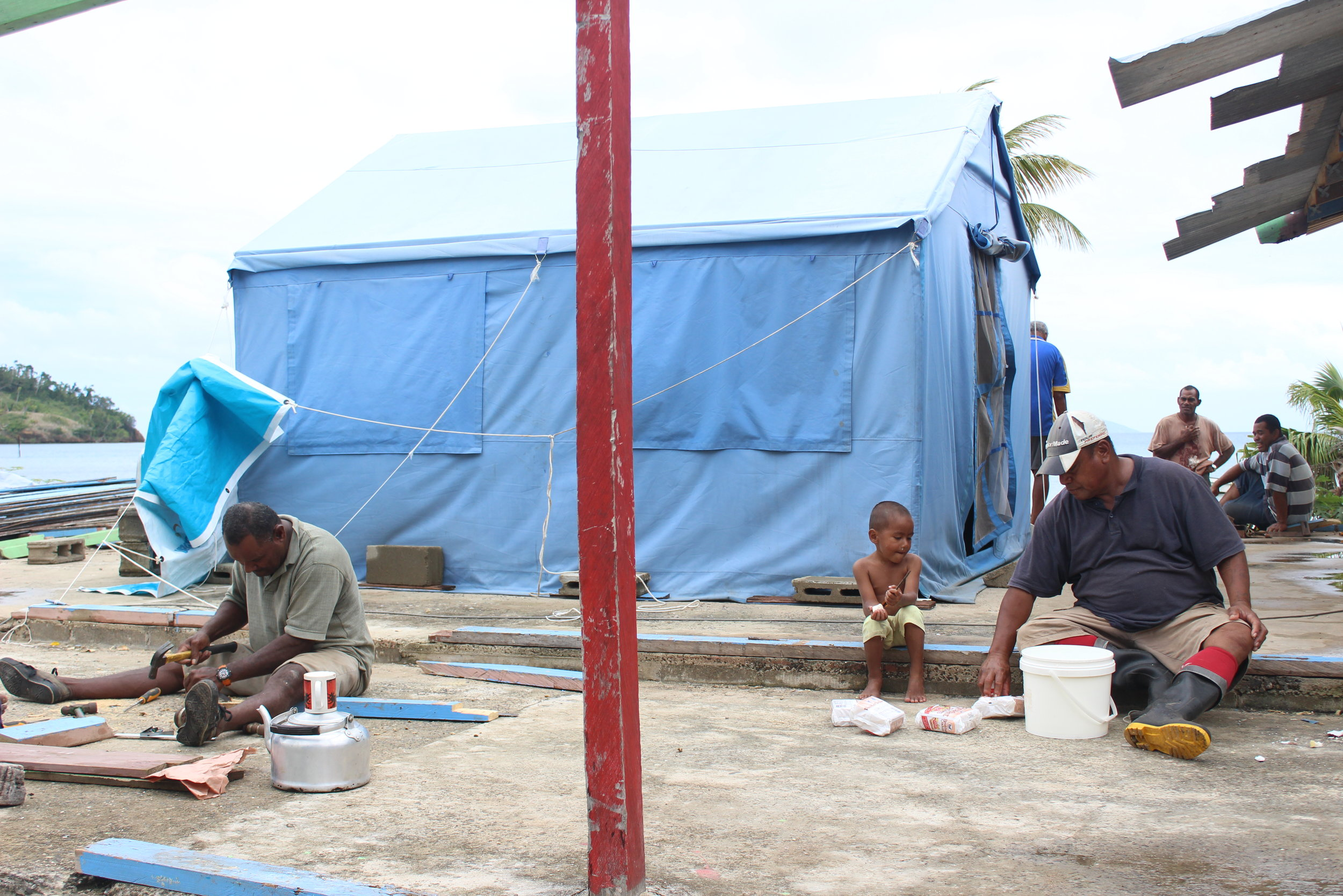 Travelling opens your eyes to many experiences and lessons to be learnt. Here is a little boy of 4 years old eating his breakfast on the job sight with his father. His breakfast consists of dry biscuits and water. the village was recovery from cyclone damage.