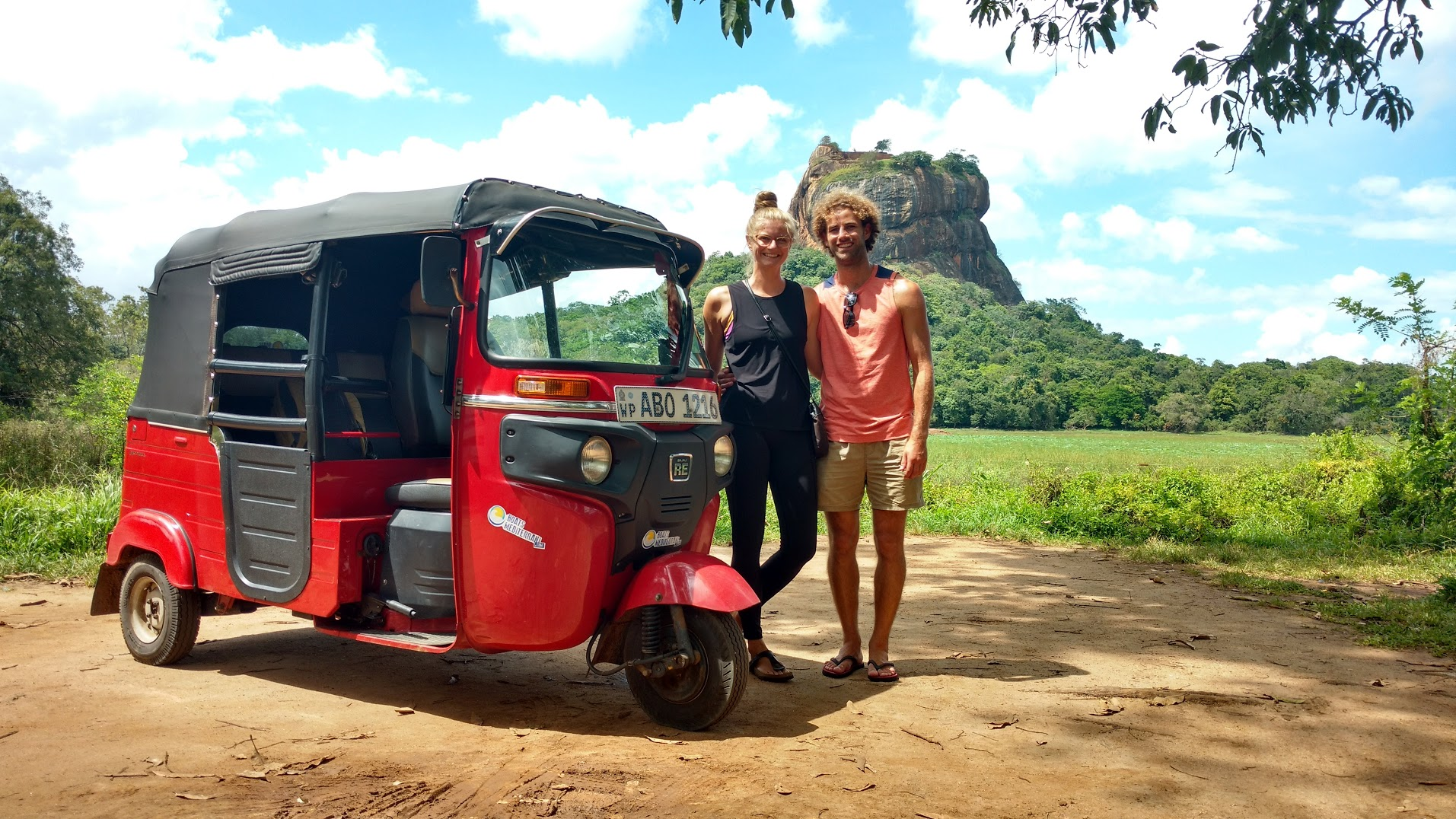 Estelle and I showing off our trusty mode of transport, Pippin, while we were touring Sri Lanka. Photo taken in front of Lion Rock, Sigiriya, by a friendly taxi driver.