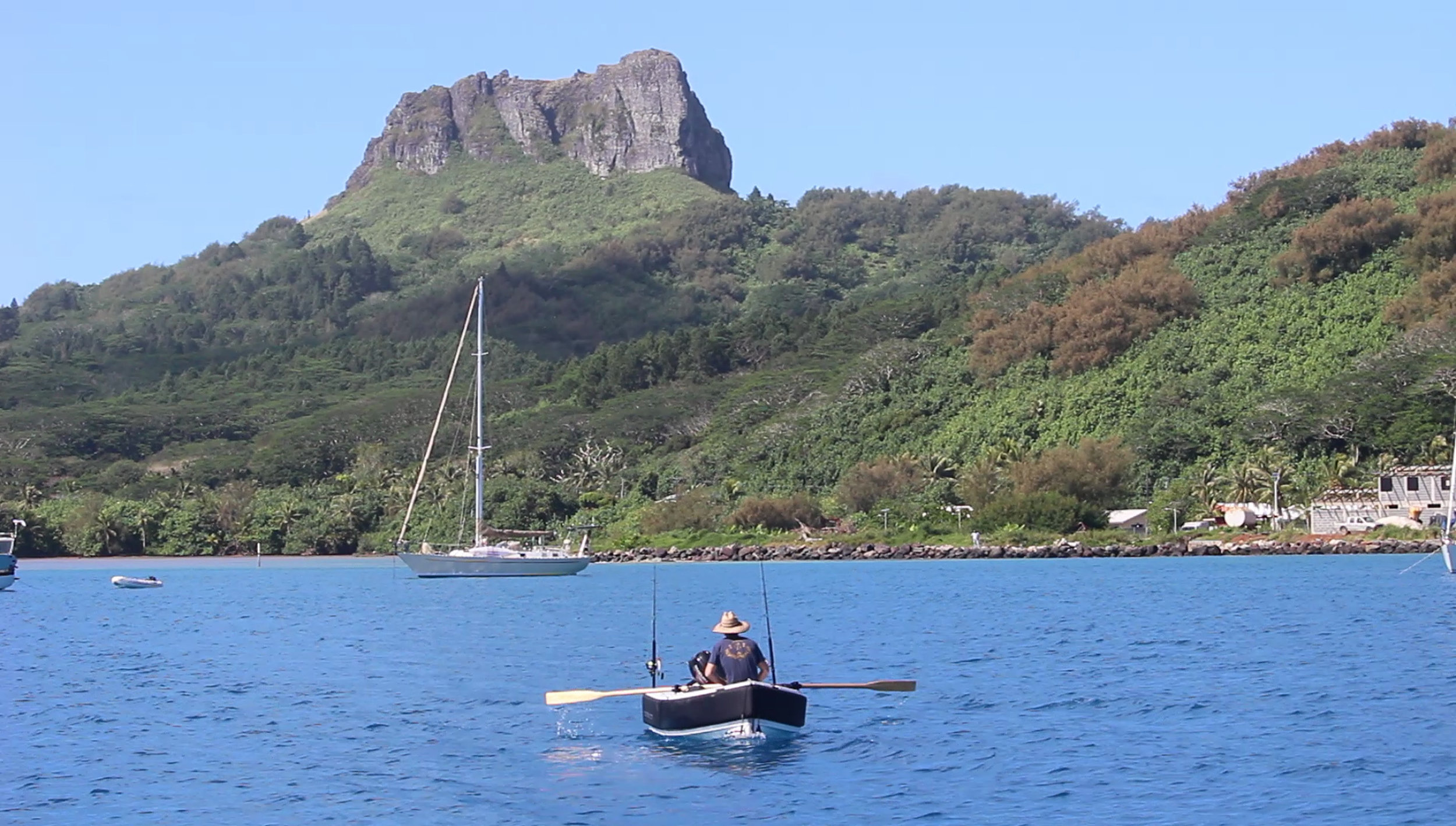 Mick Rowing back to Roam in the main anchorage