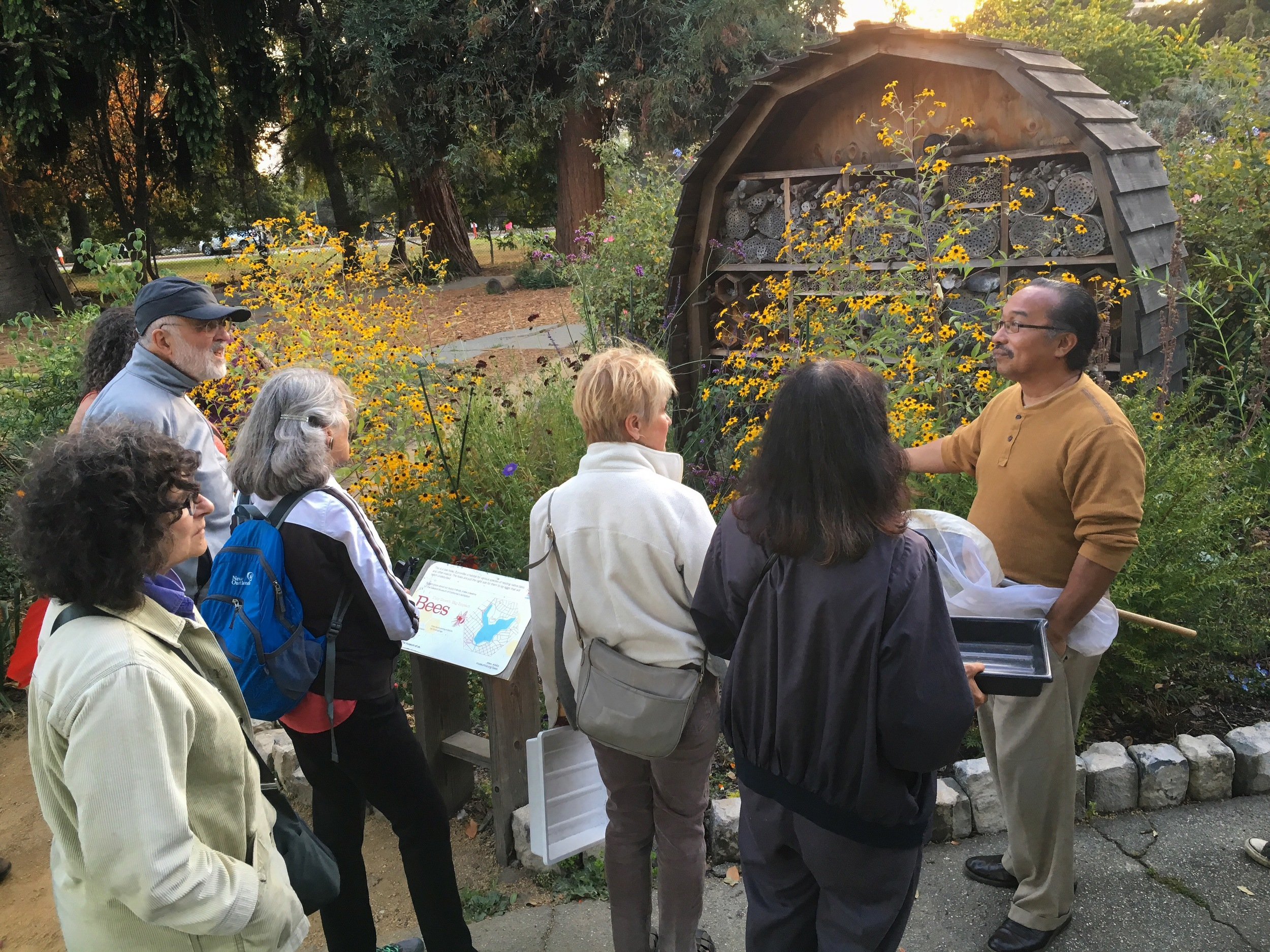 ISMC's Executive Director Eddie Dunbar and workshop attendees in front of the Bee Hotel