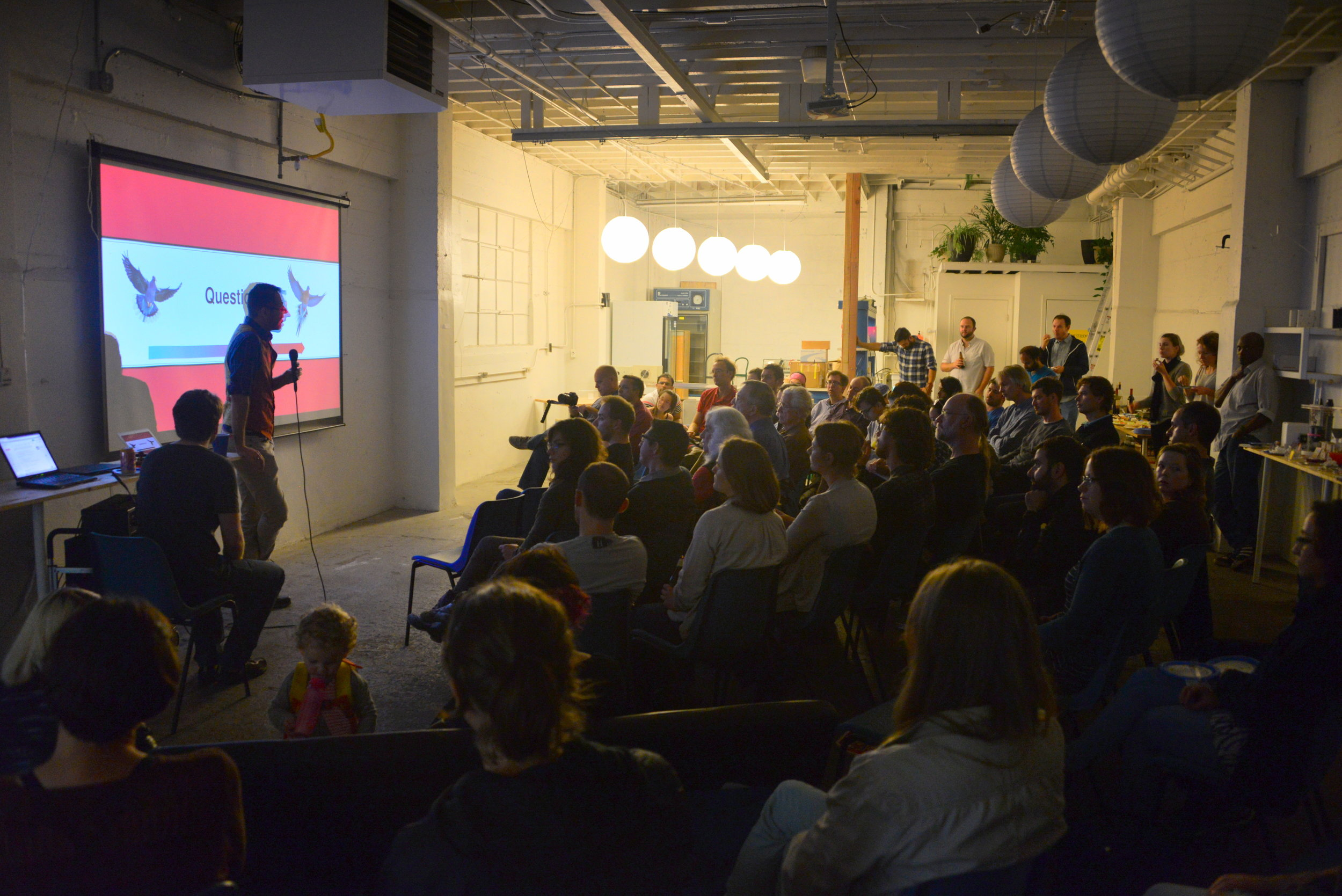 A full house at the Open House made for good networking and provocative questions during Science Salon presentations.