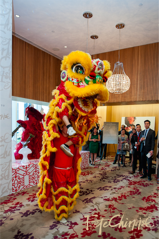 WuShu Project performs lion dance in front of a runway entrance by Caspar Haydar.By Krista Fox Photography