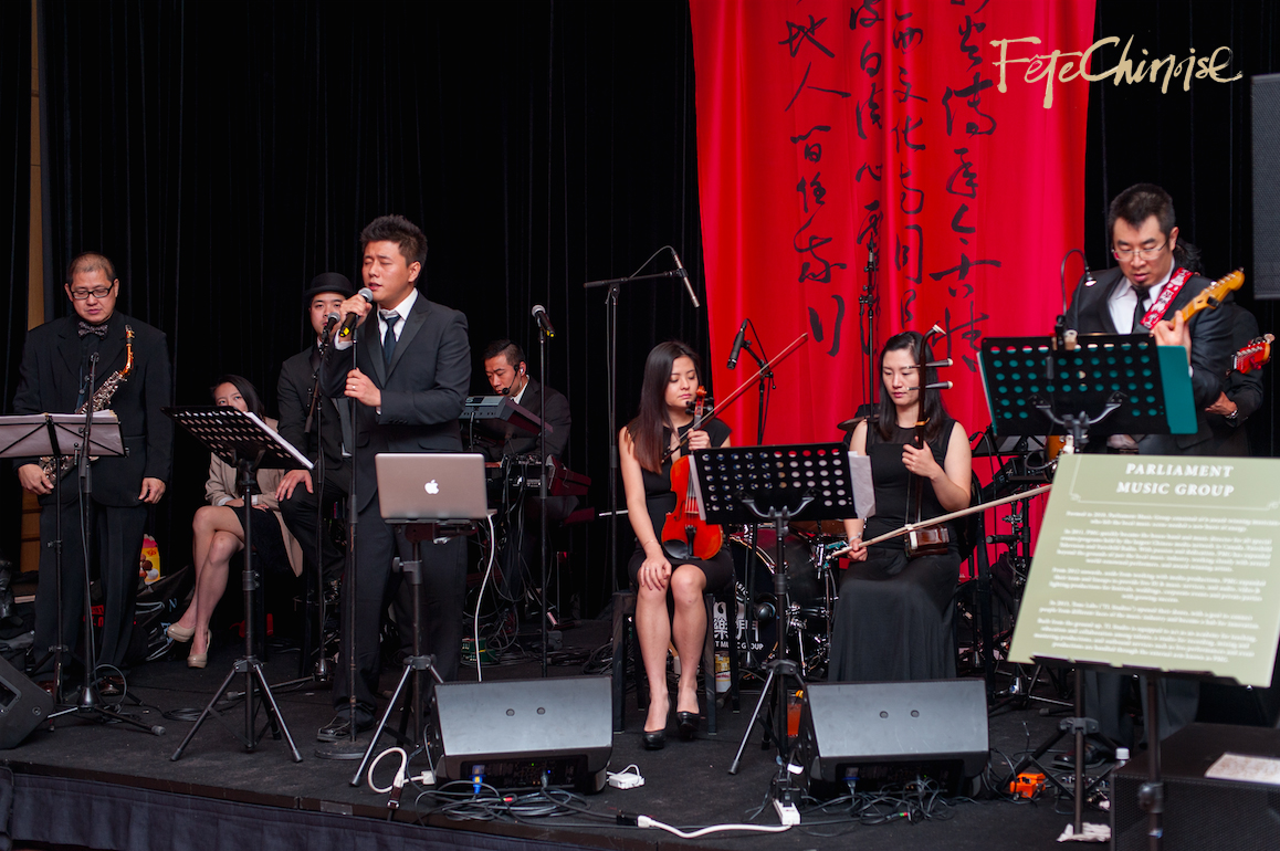 In the Marketplace: Parliament Music Group   performs for a beautiful crowd. Photo by Krista Fox Photography.