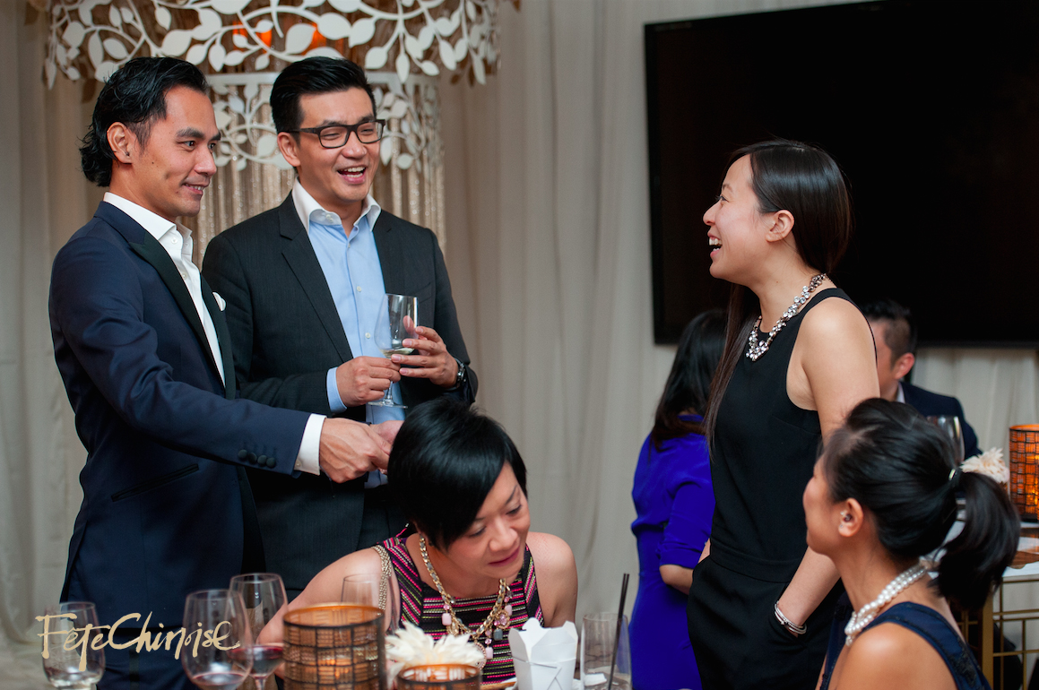 Guests enjoying themselves inside the Dai Pai Dong of King Room, Shangri-La Hotel, Toronto.   Design in the background by nous design group. Photo by Krista Fox Photography.