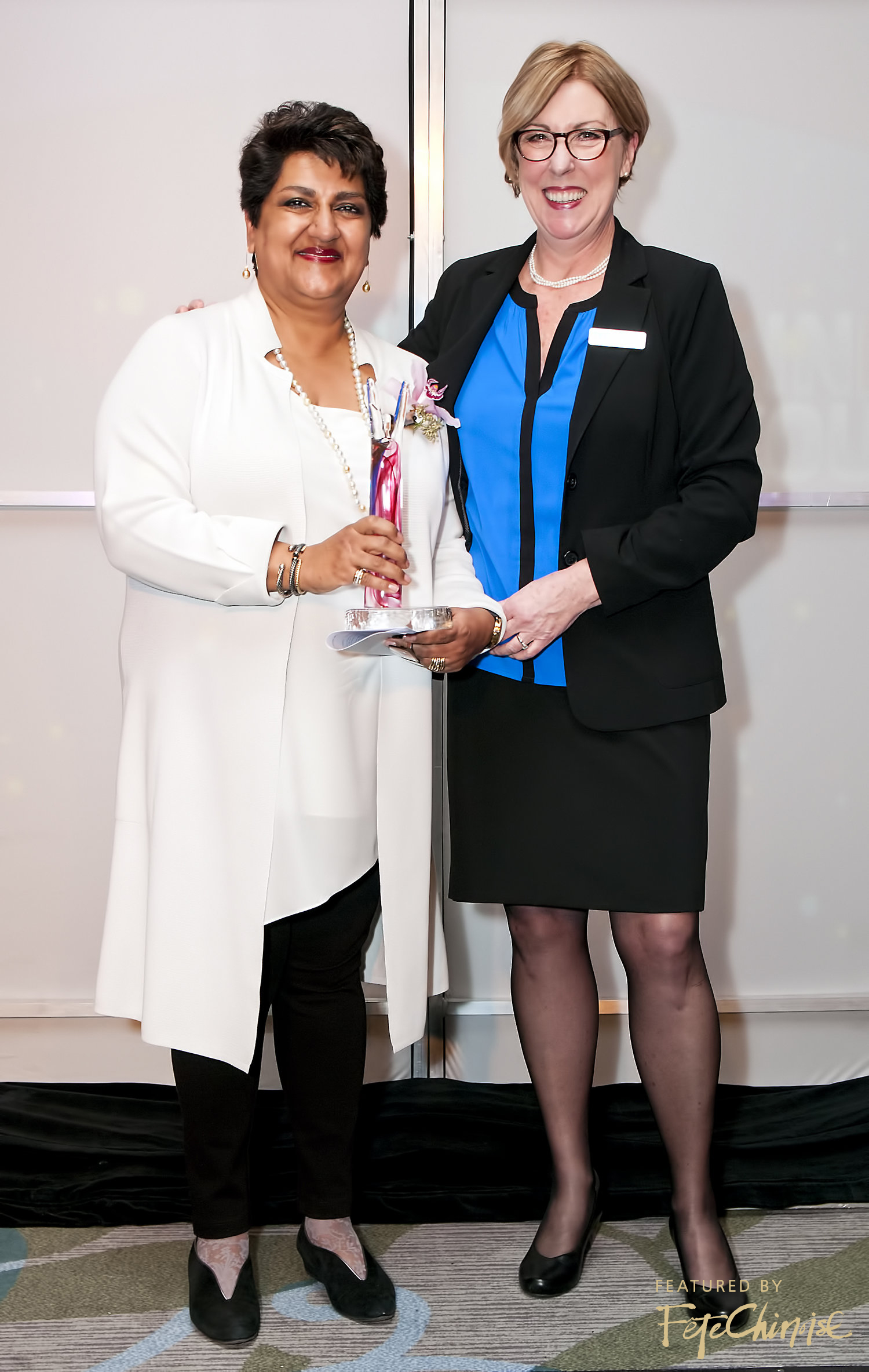 Karimah Es Sabar of the Centre for Drug Research and Development accepts her award from Janet Davie of TEC Canada.