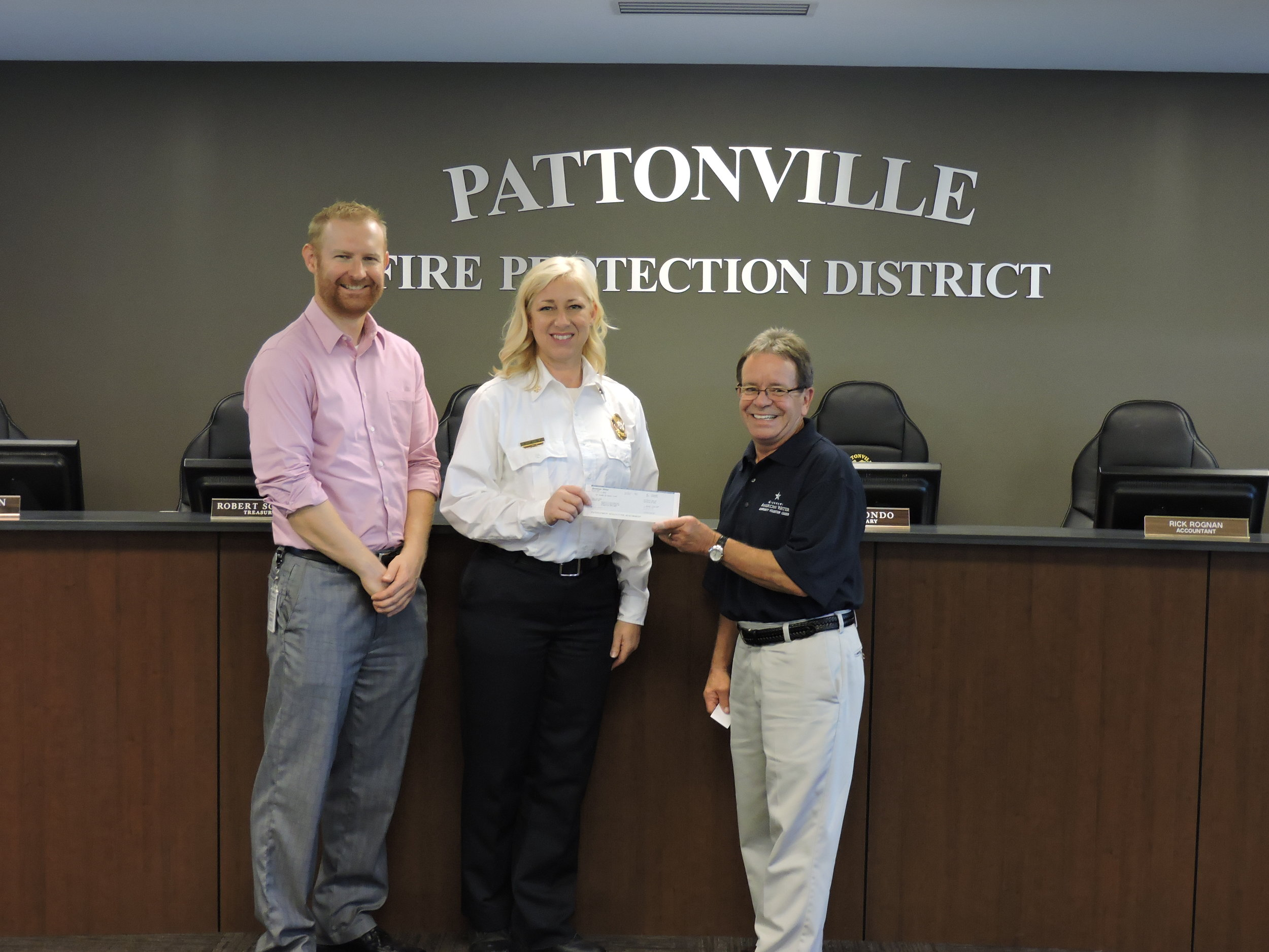 November 1, 2016:  Deputy Chief/Fire Marshal Laurie Taylor accepts a grant award on behalf of PFD from Missouri-American Water Company at Pattonville Fire Protection District Headquarters.