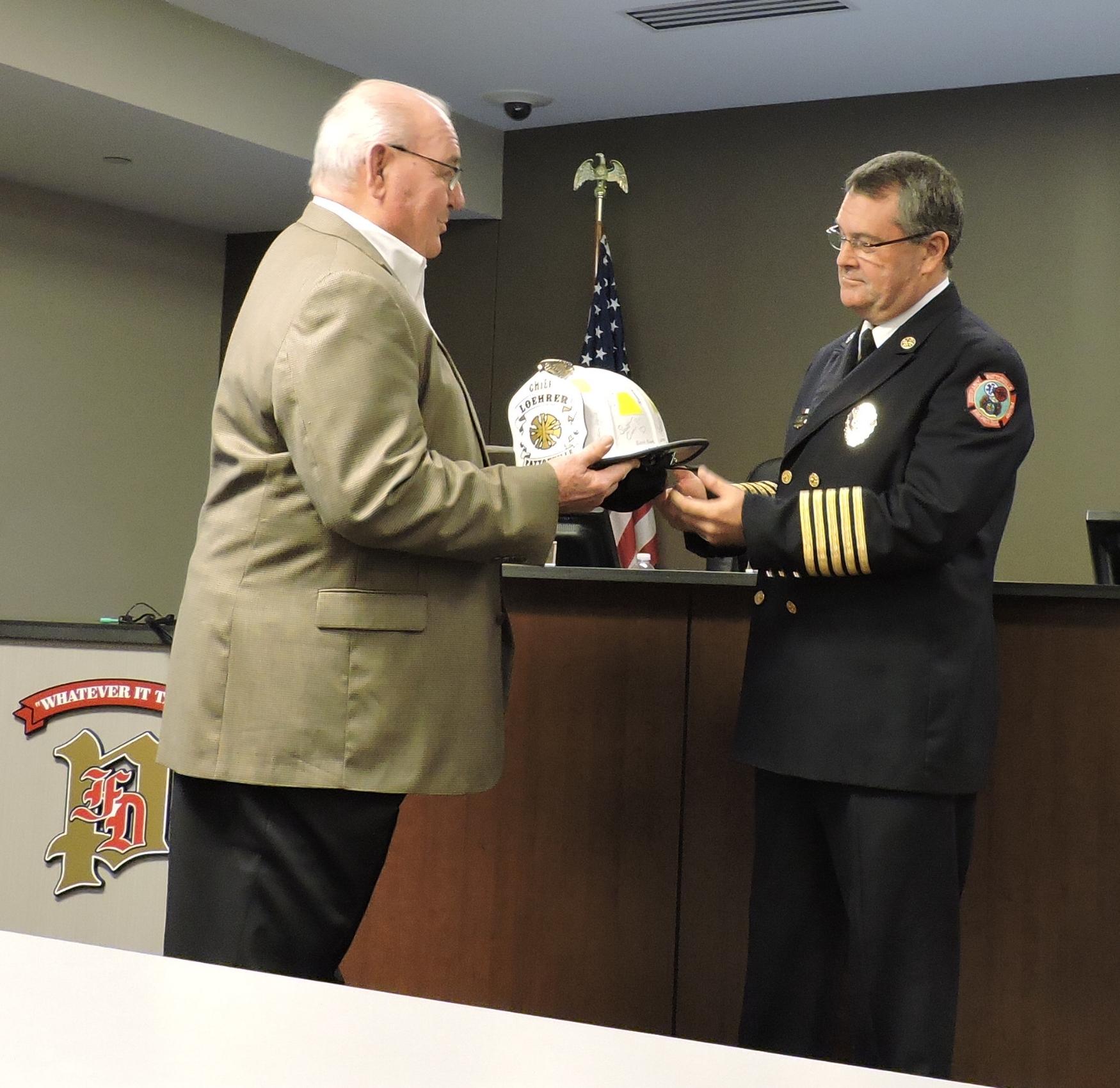 Left to Right: Board Chairman Bill Esterline, Retiring Fire Chief Terry Loehrer.