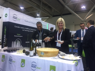 Precise ParkLink's Booth At Health Achieve, 2016, Serving Wine & Cheese