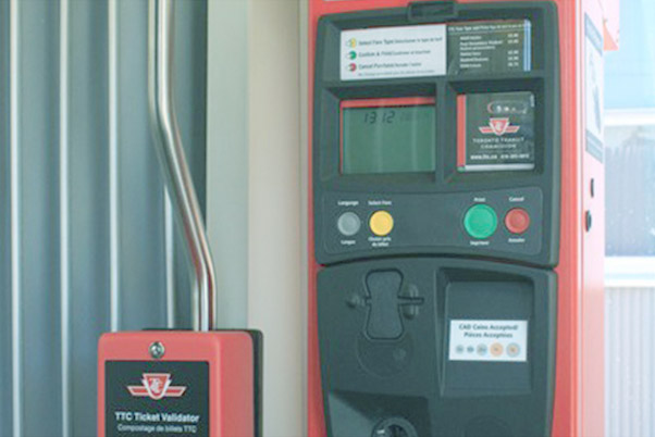 """Transit Vending & Validations - Our transit ticket vending pay stations can be programmed to print """"single ride"""" tickets in exchange for cash or city transit tokens. A validator next to each pay station stamps the date and time on tickets enabling transfers."""