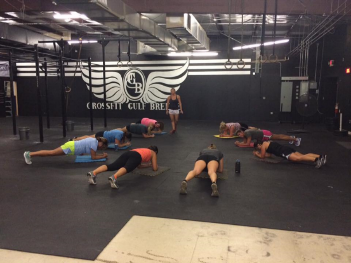 Coach Candace observing planks during a CFGB Bootcamp class