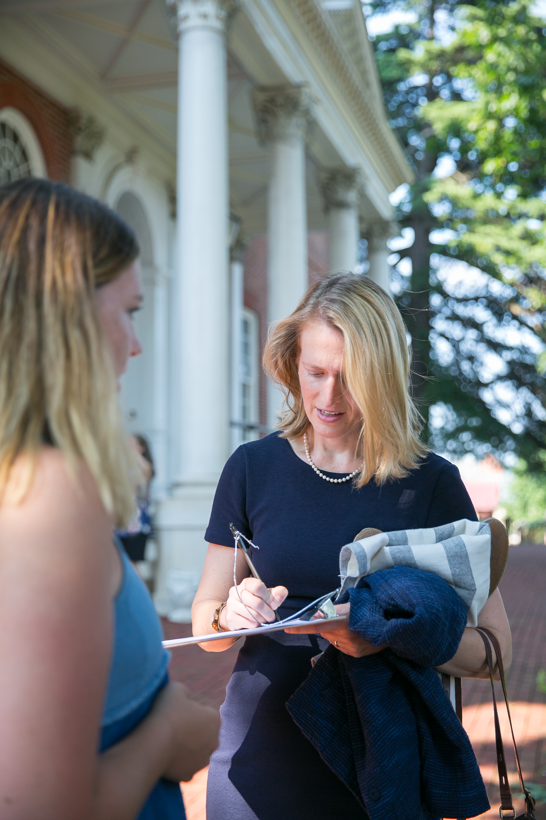 Del. Brooke Lierman signing into the event after canvassing for another friend running for office  Photo: Raba Abro