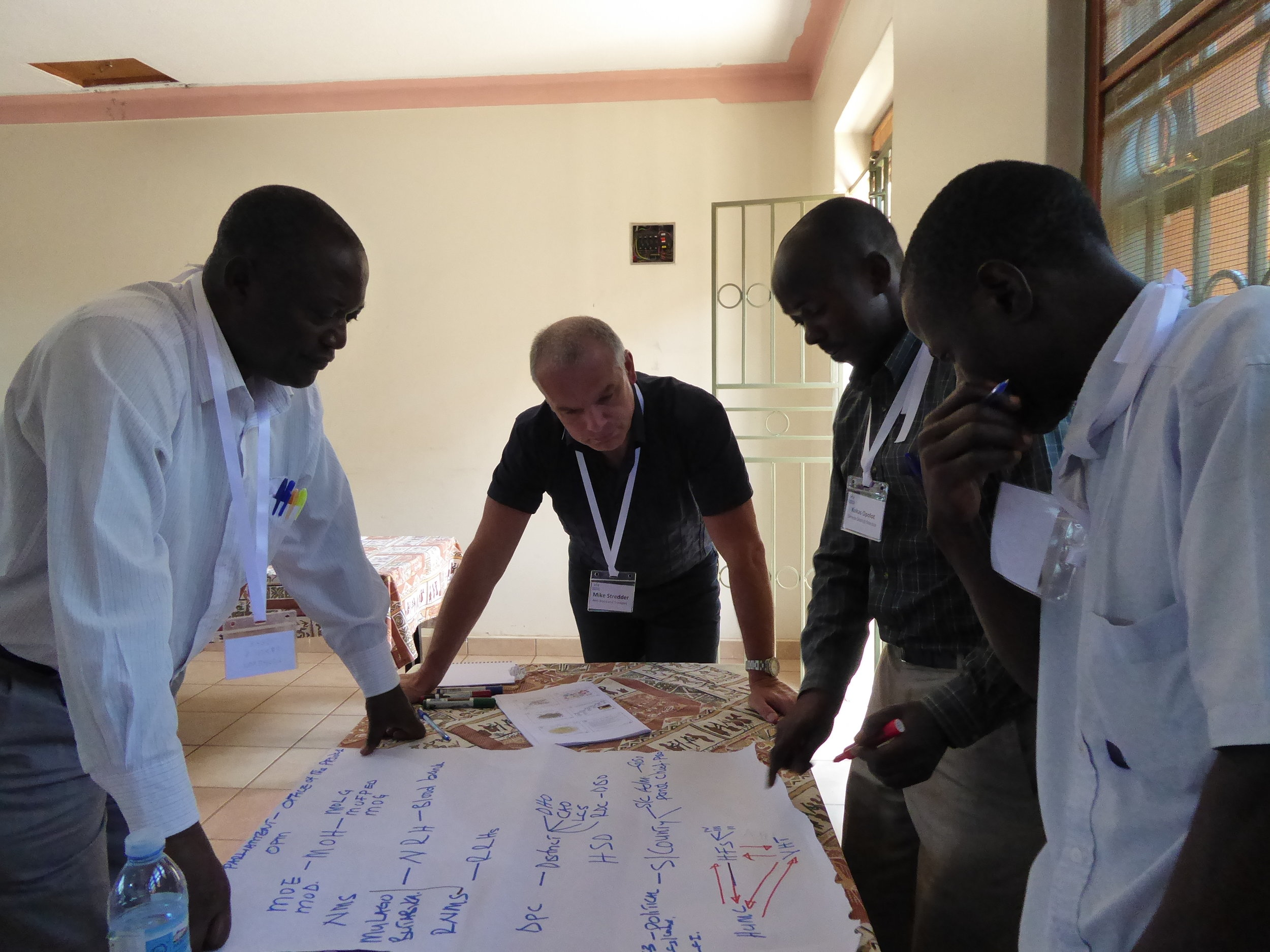 Mike Stredder, Director, NHS Blood and Transplant, works with Ugandan colleagues.