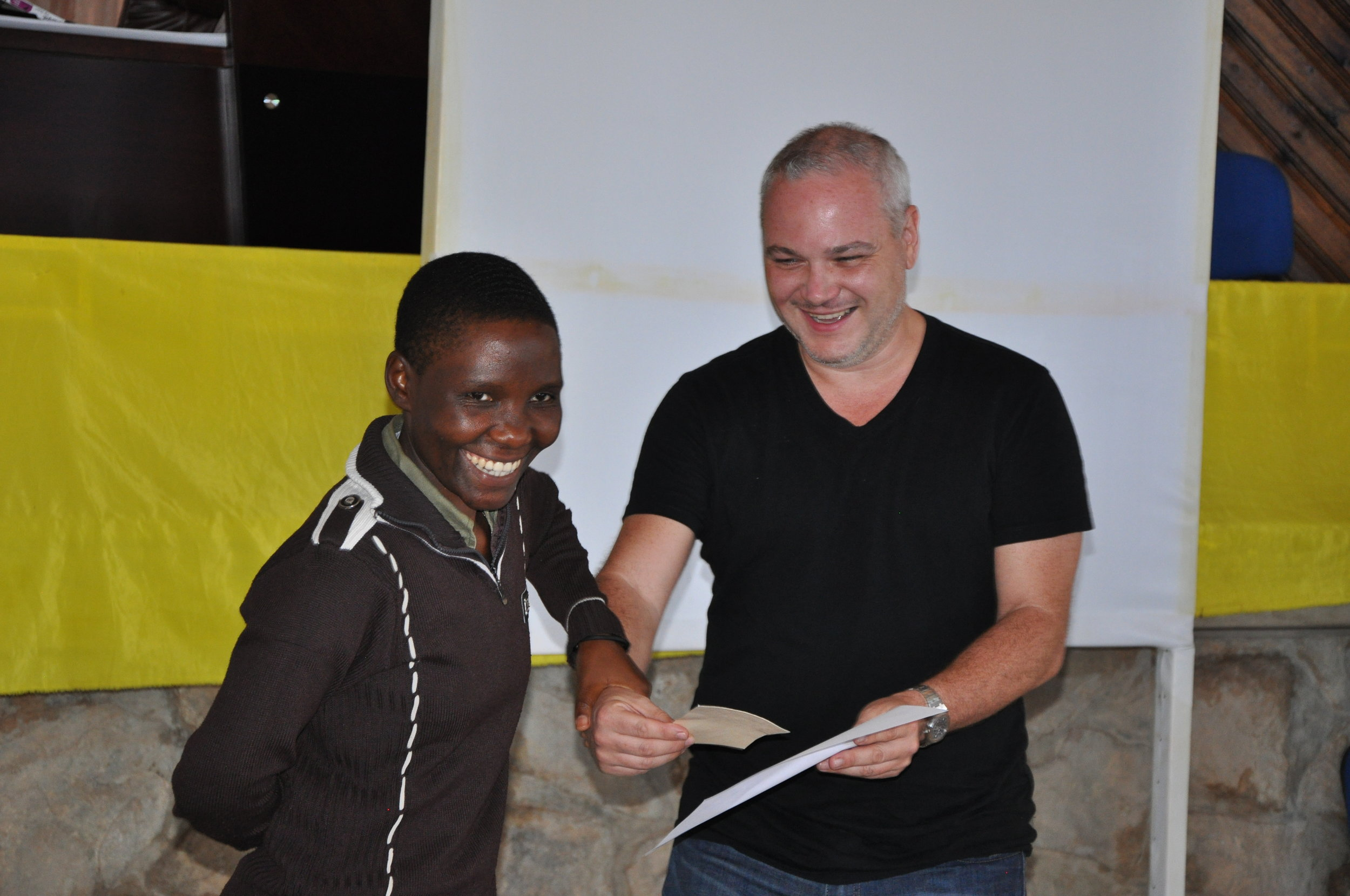 Anicia Kamugisha, ICAP COV Bukoba MC and JJ Palombo, Roche Pharmaceutica