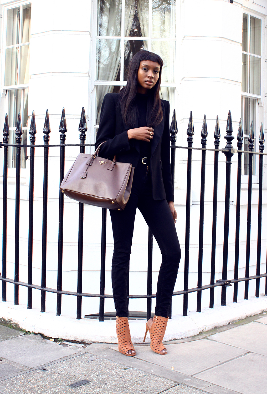 justthedesign :      Street Style, March 2015 :  Natasha Ndlovu  is wearing a black Zara blazer with an Asos turtleneck, American Apparel jeans and Missguided camel heels     Shoes on point