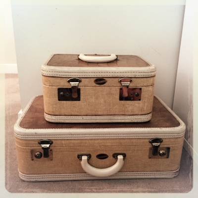 Micha adores vintage luggage and uses it to store paperwork