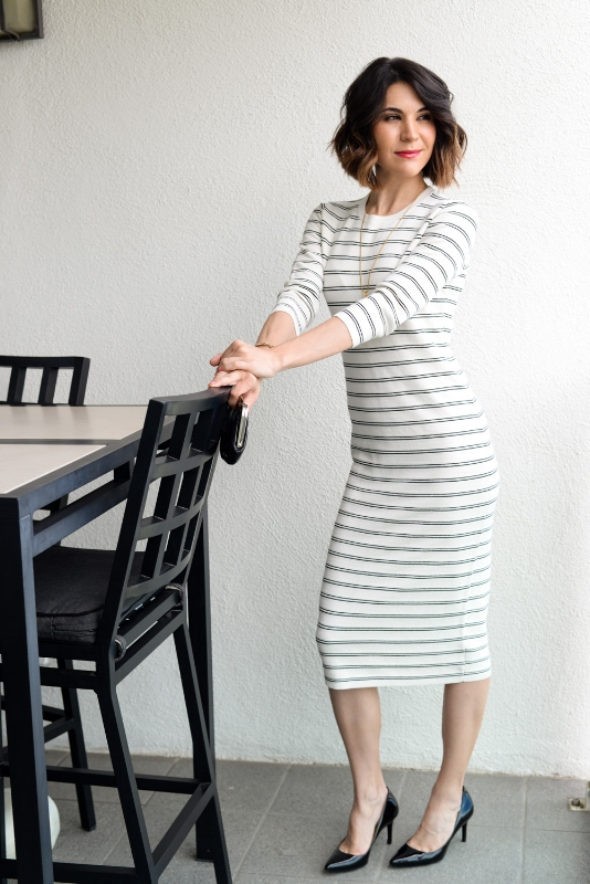 Gianelle Veis, founder of The Opportunista, contemplates her next move in comfortably chic striped dress