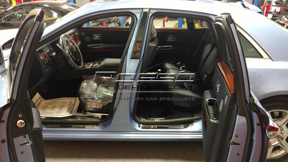 Rolls Royce Ghost shop doors open.jpg