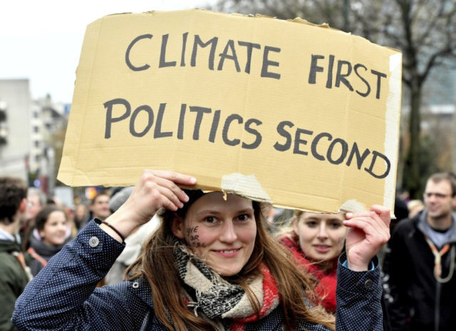 cb4b68_belgium-climate-55123-demonstrator-holds-placard-reads-climate-politics-640x465.jpg