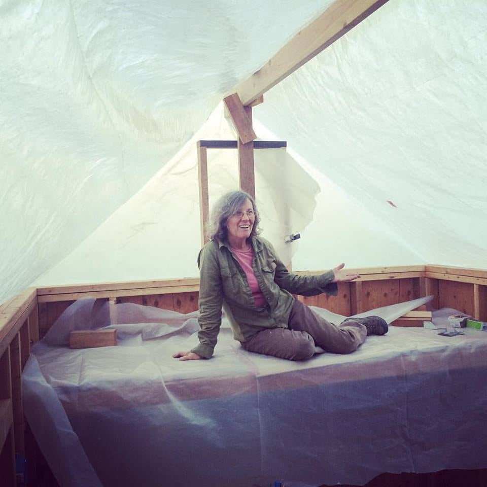 Lisa in her storage loft before we put the roof on.