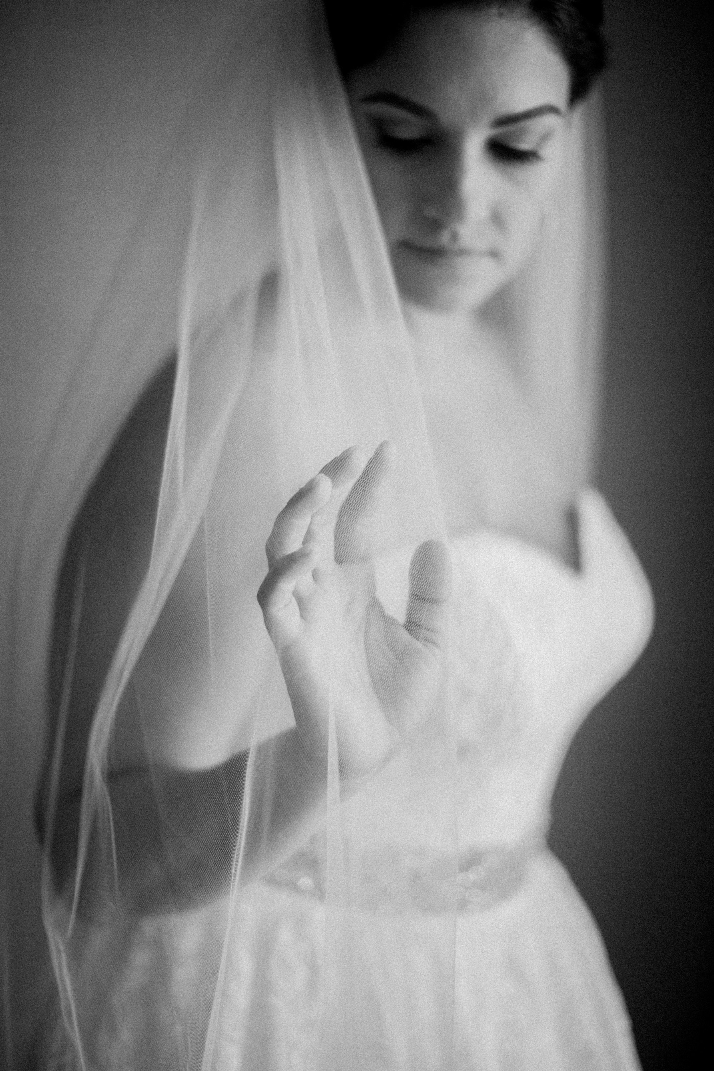 I love this image of Liz getting ready, as she slowly runs her fingers through the fabric of her veil on her wedding day.