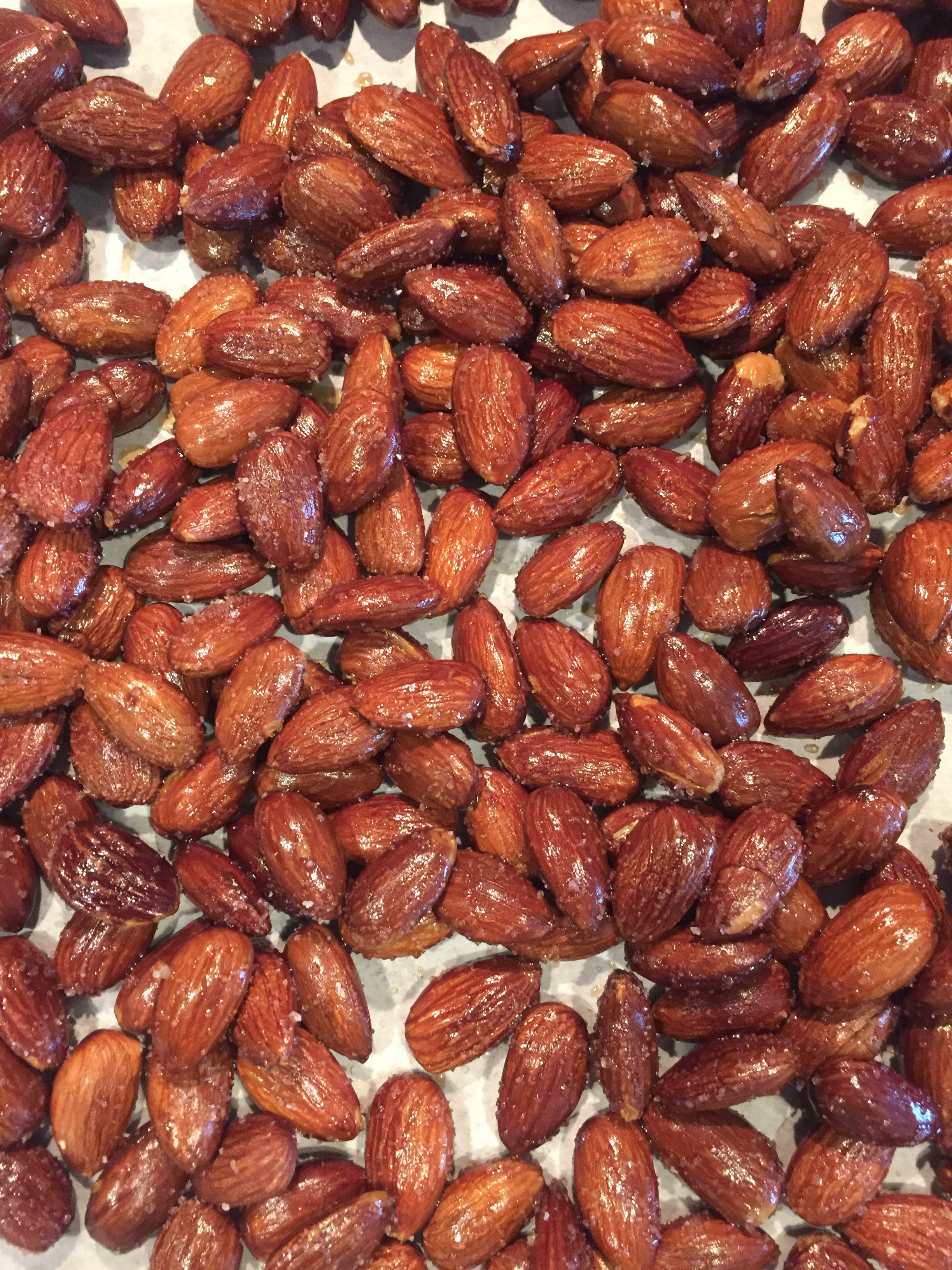 - That's why I've taken to roasting my own almonds. I start with organic, whole, raw almonds, throw them in the oven then toss with olive oil and salt.Deeeee-licious!