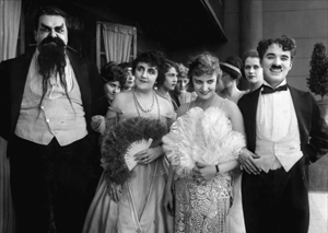Cast of THE ADVENTURER from left to right: Eric Campbell, Marta Golden, Edna Purviance, Charlie Chaplin