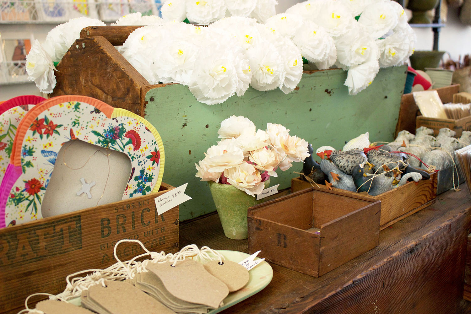 With a wide array of irresistible trinkets, like these paper lanterns and flowers, Bon has something for everyone.