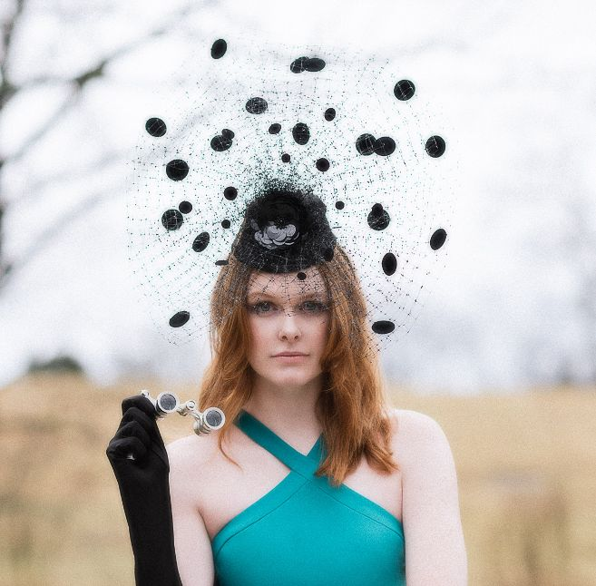 Photo by  Adrian Morales  featuring a fascinator by Los Angeles milliner,  Arturo Rios , and dress from  Stacey Rhodes Boutique  with model  Emily Grace King .