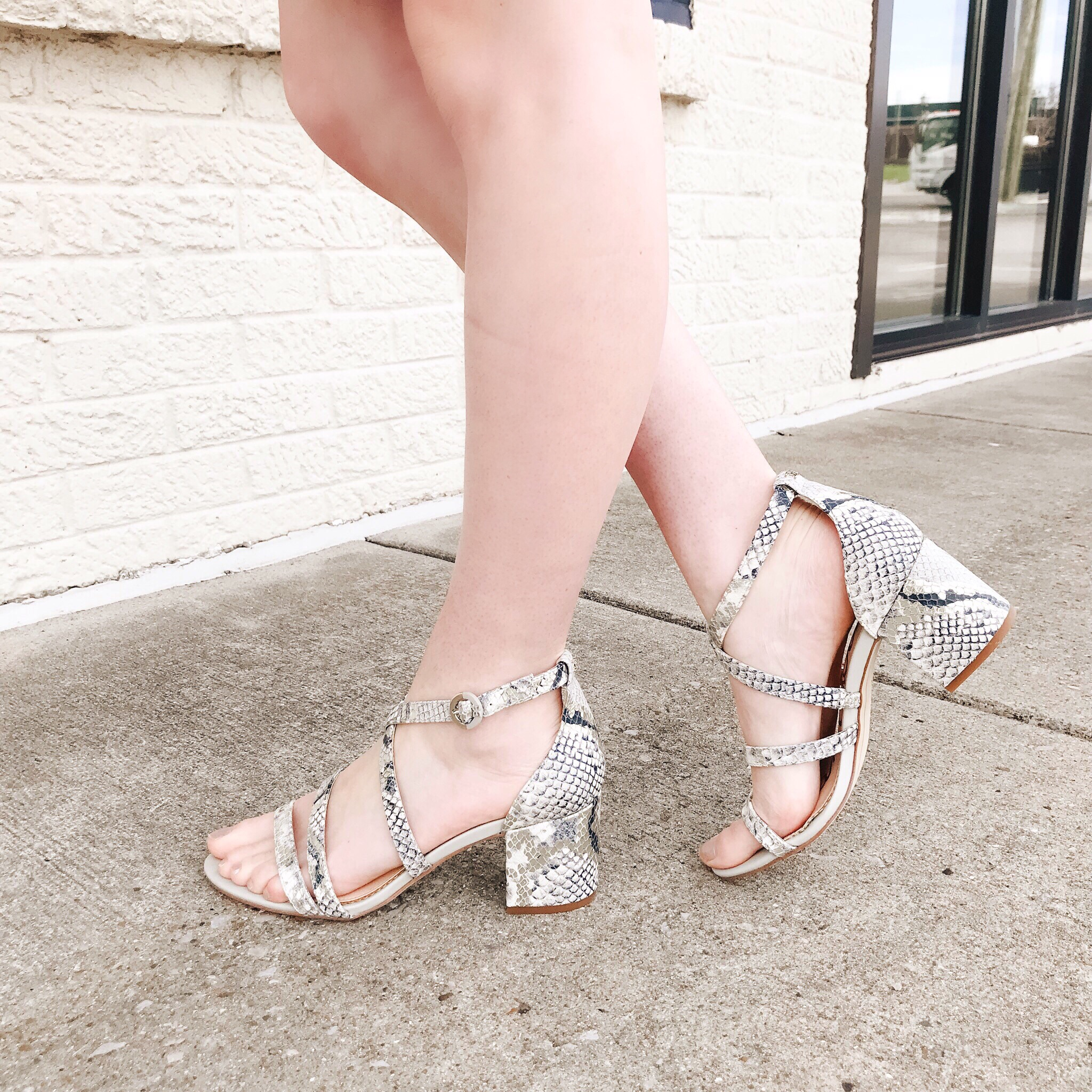 Pop of Print - We added a playful pop of print to this overall neutral look with these snakeskin sandals!