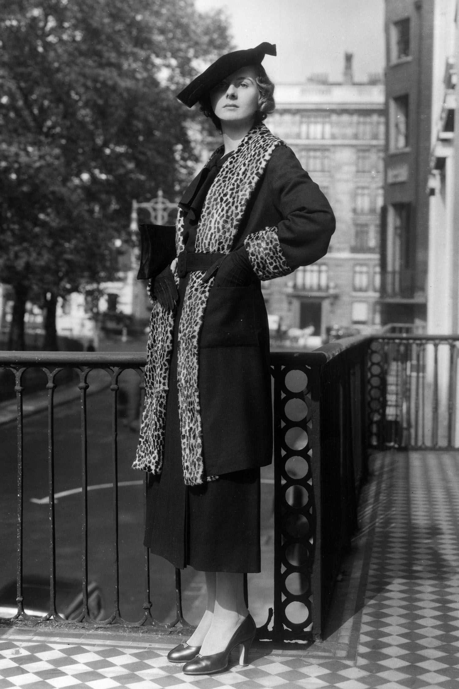 Model wears a long and lean coat from the '30s with leopard fur accents. Photo courtesy of Harper's Bazaar.