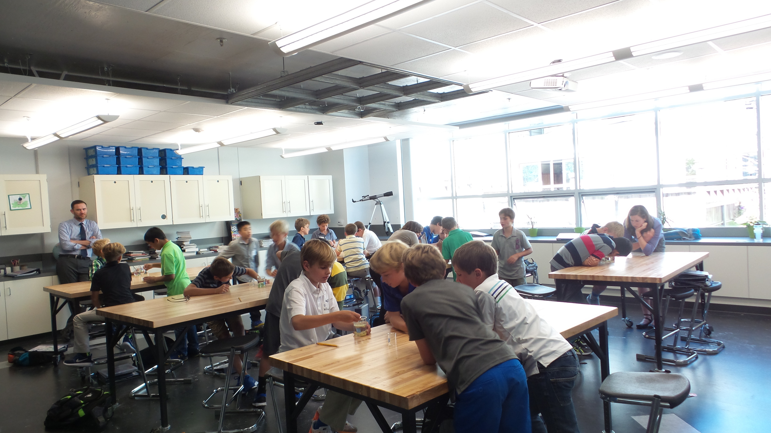 5th grade boys investigating a magical sand-like material.