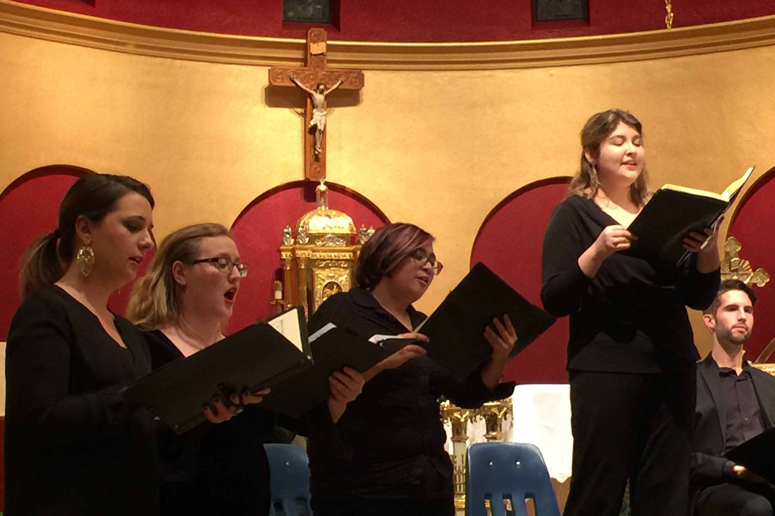 Left to right, Julianna Emanski, solo soprano; Amanda Jacobsen, soprano; Francesca Cacal, alto; Hannah Ceniseros, solo alto; Barrett Radziun, tenor soloist, seated.