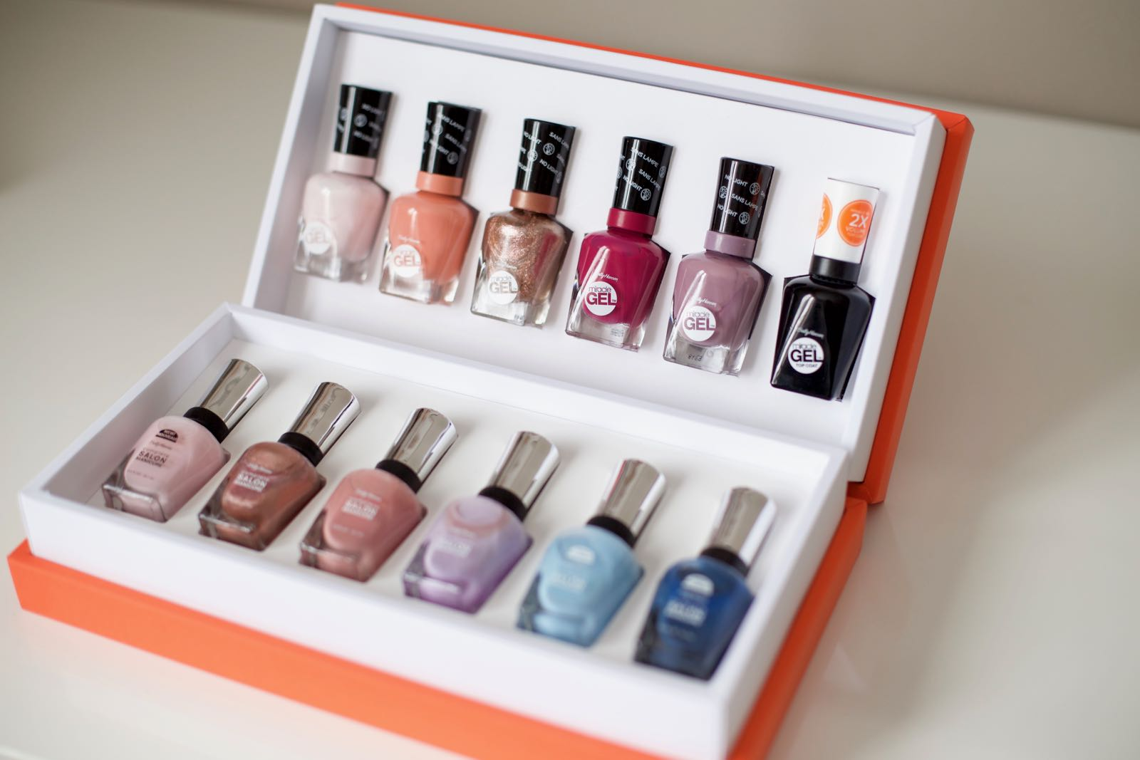 First row (from left to right): Little Peony, Bourbon Belle, Terra Coppa, Mötley Hue, Street Flair, Top Coat.  Second row (from left to right): Stellar Style, World is My Oyster, Pink Pong, What is Carnation?, Dream Boat, Tropic Thunder.
