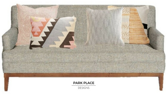 Jonathan Sof  a  from Gingko Furniture, throw pillows L-R: Bandana Pillow, Plum & Bow Tepeck Kilim Pillow, 4040 Locust Shade Pillow, Colorblock Woven Loop Pillow all available at  Urban Outfitters