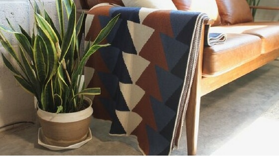 - My go-to in chic, cozy throws: Happy Habitat A KCMO based small, woman-owned biz! Pictured is the Stacked pattern in cobalt/cinnamon/linen/slate
