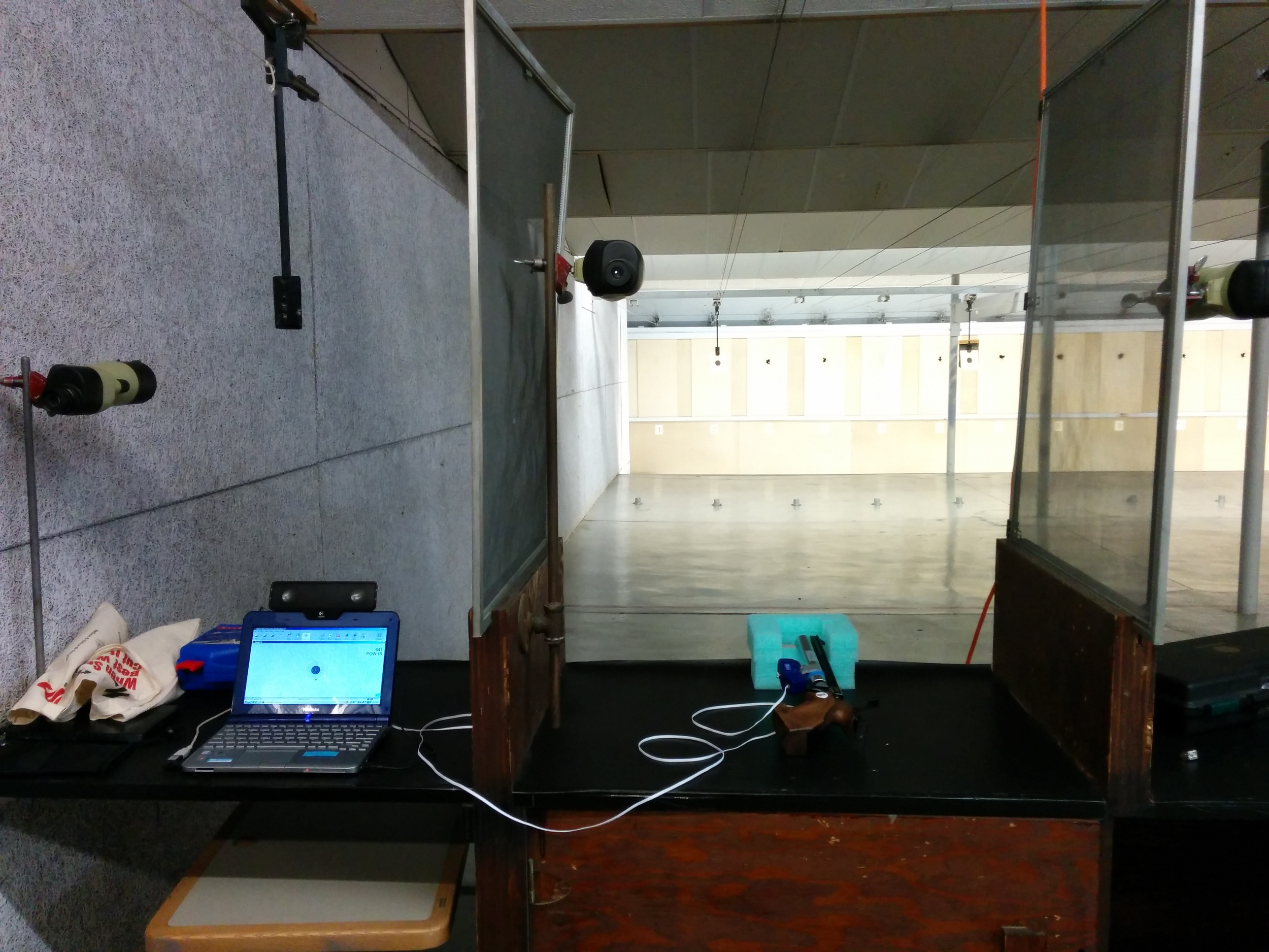 The complete experimental setup on a 10m air pistol range.