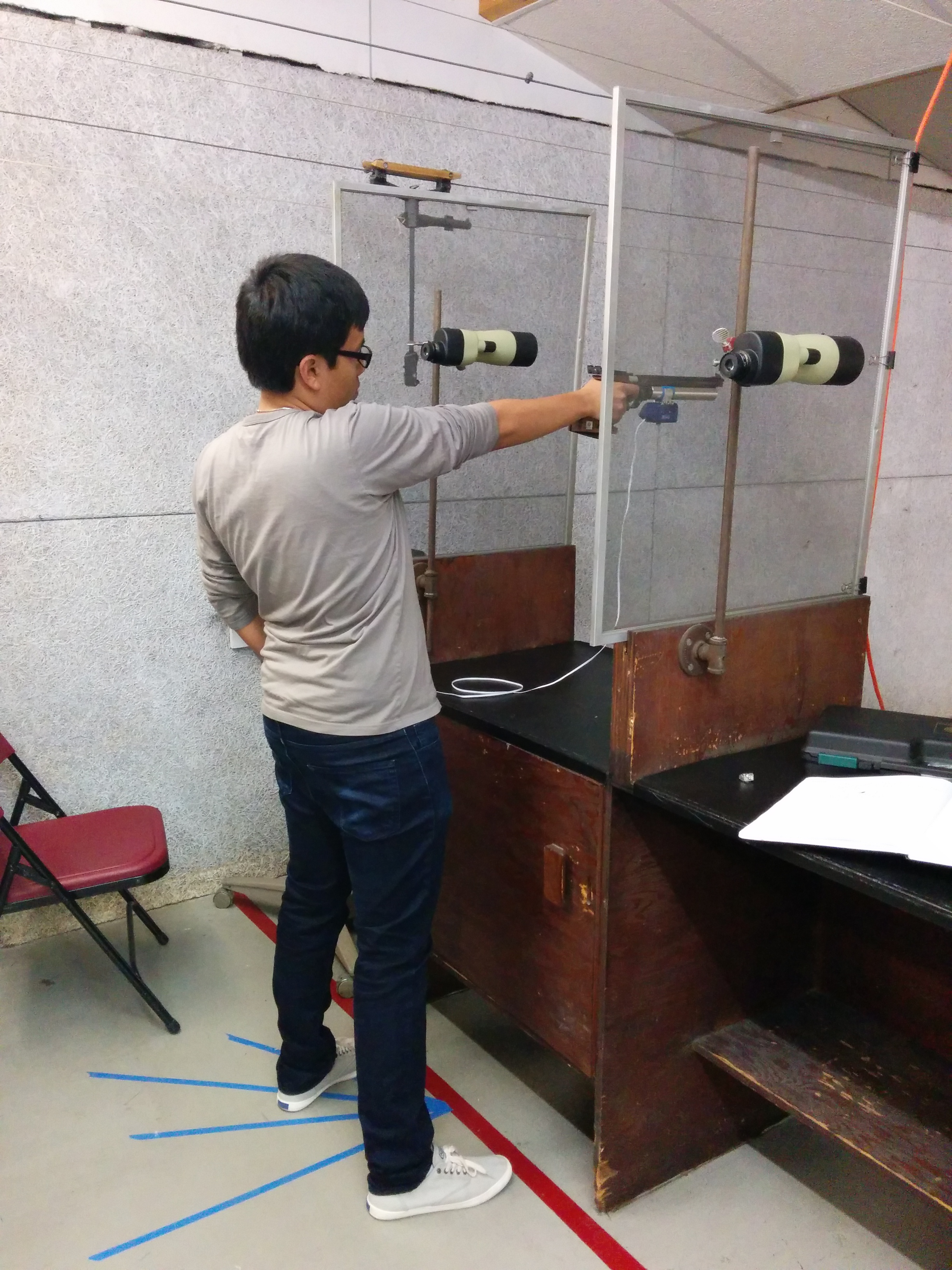 In Olympic-style shooting, the pistol is operated from a standing, unsupported position. I am shown executing a standard shot process.