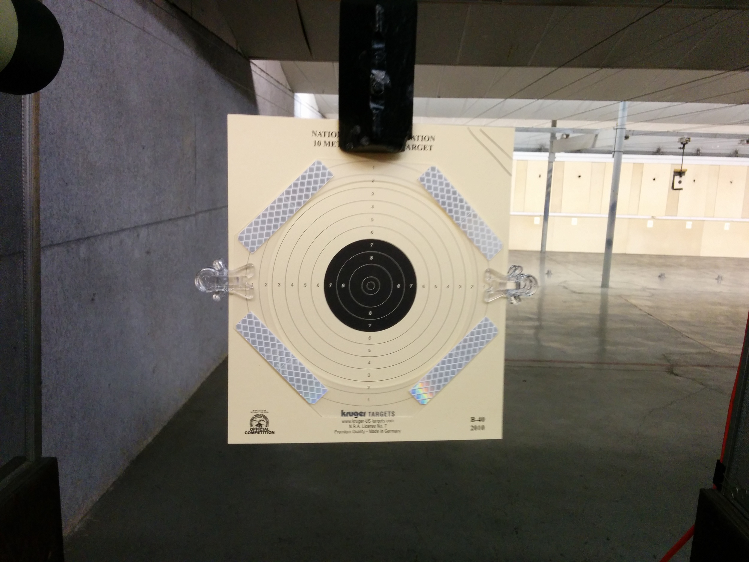 The testing setup included a 10m air pistol target with reflective tape.