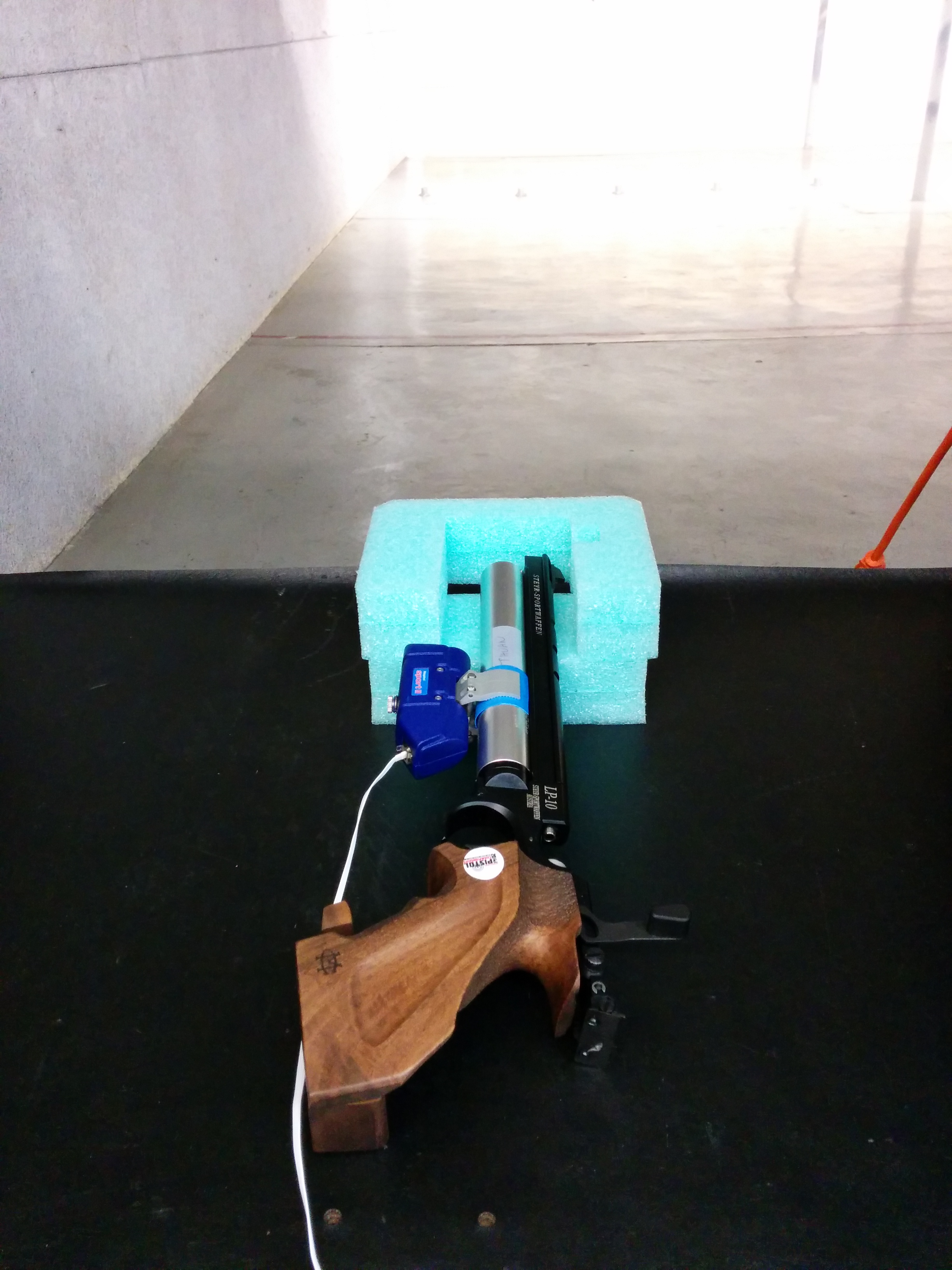 The air pistol was attached with an optoelectronic unit that was connected to a laptop to record position data.