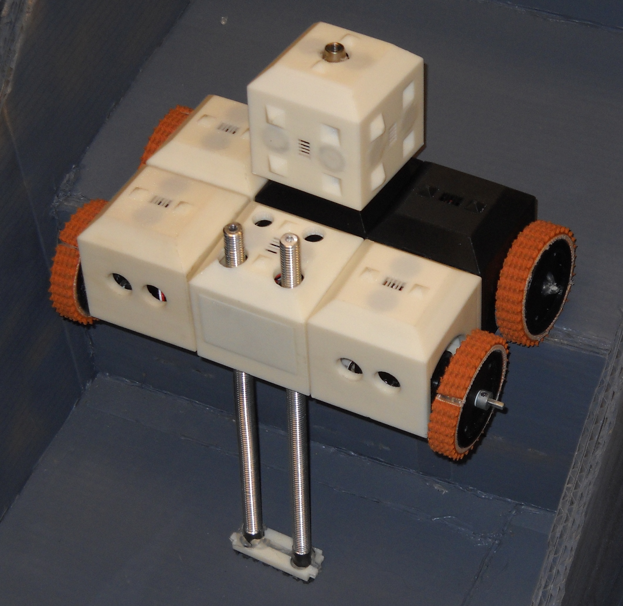 This was the stair climbing, fire-fighting configuration for the system. The stair climbing mechanism was two motor-powered, threaded rods.