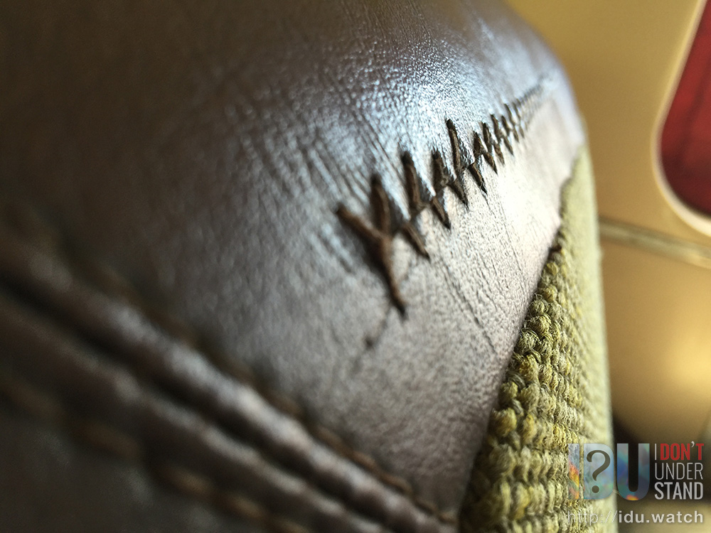 "Details: Stitching on the ""leather"" seats."