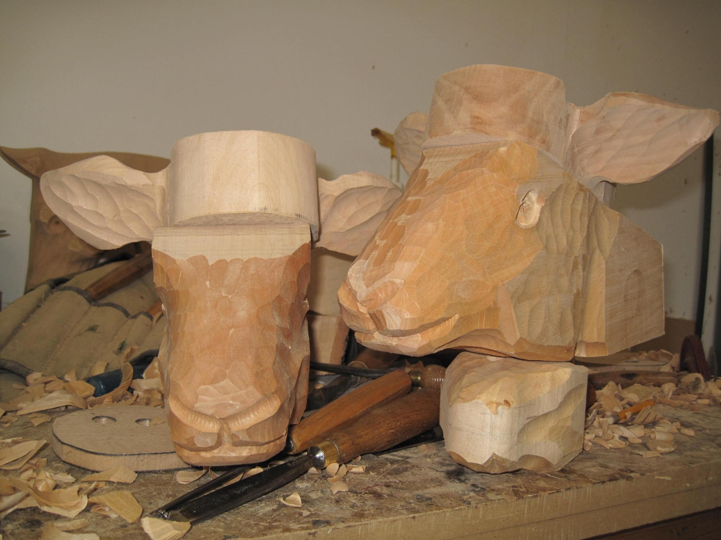 carved heads IMG_4242.JPG